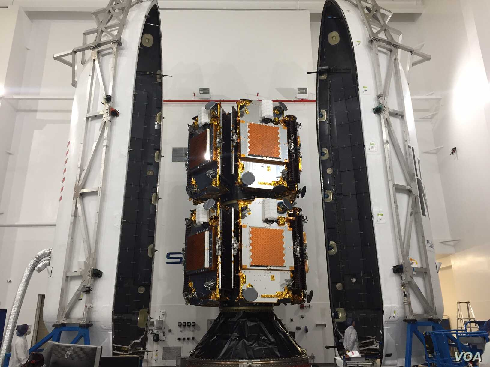 """This is a photo of the first 10 Iridium NEXT satellites, inside the SpaceX """"dispenser,"""" the payload fairing used to protect the satellites during the rocket launch. (Credit: Iridium)"""