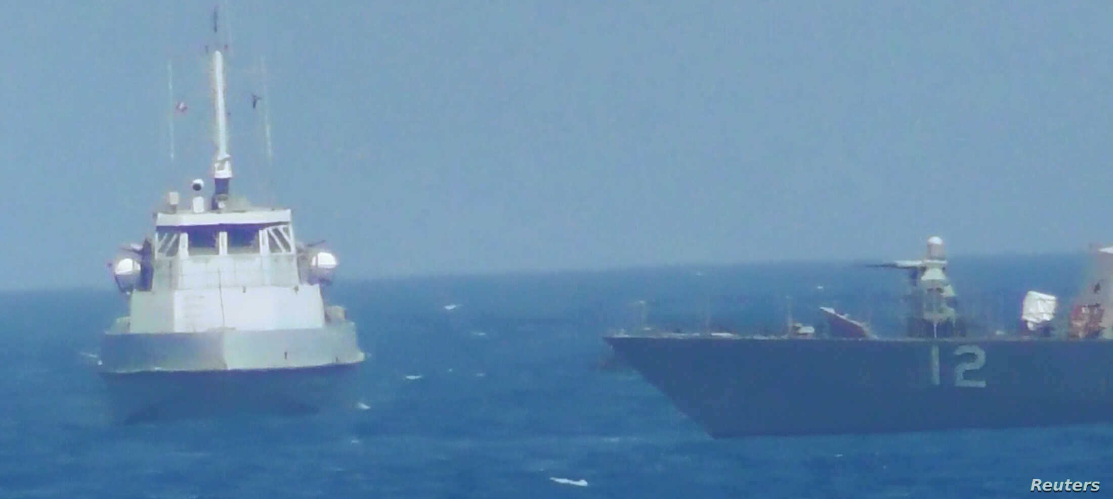 An Iranian vessel steers close to the U.S. Navy coastal patrol craft USS Thunderbolt (R) in the Persian Gulf in a still image from video provided by the U.S. Navy, July 25, 2017.
