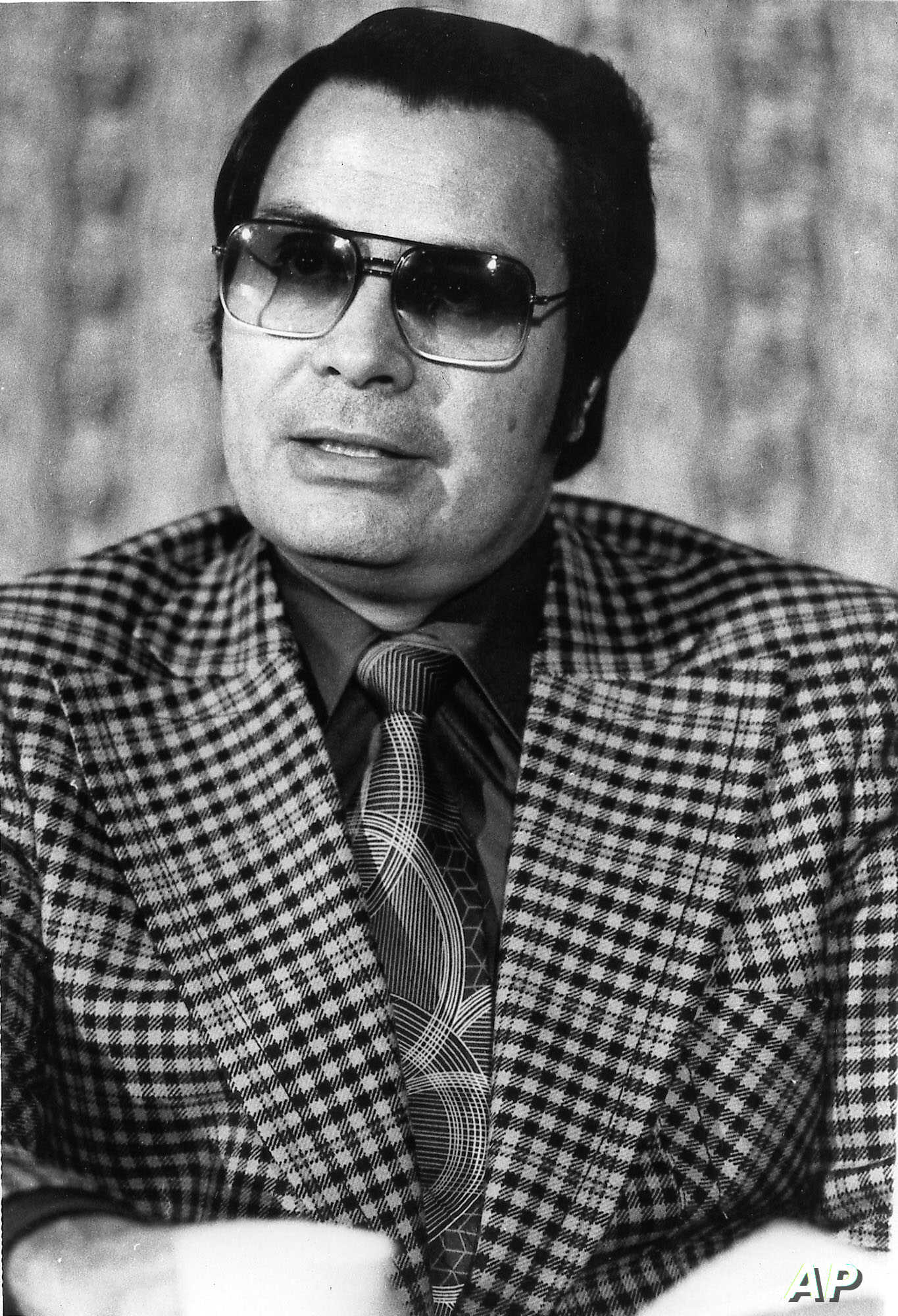 FILE - This Jan. 1976 photo shows the Rev. Jim Jones, pastor of Peoples Temple in San Francisco.