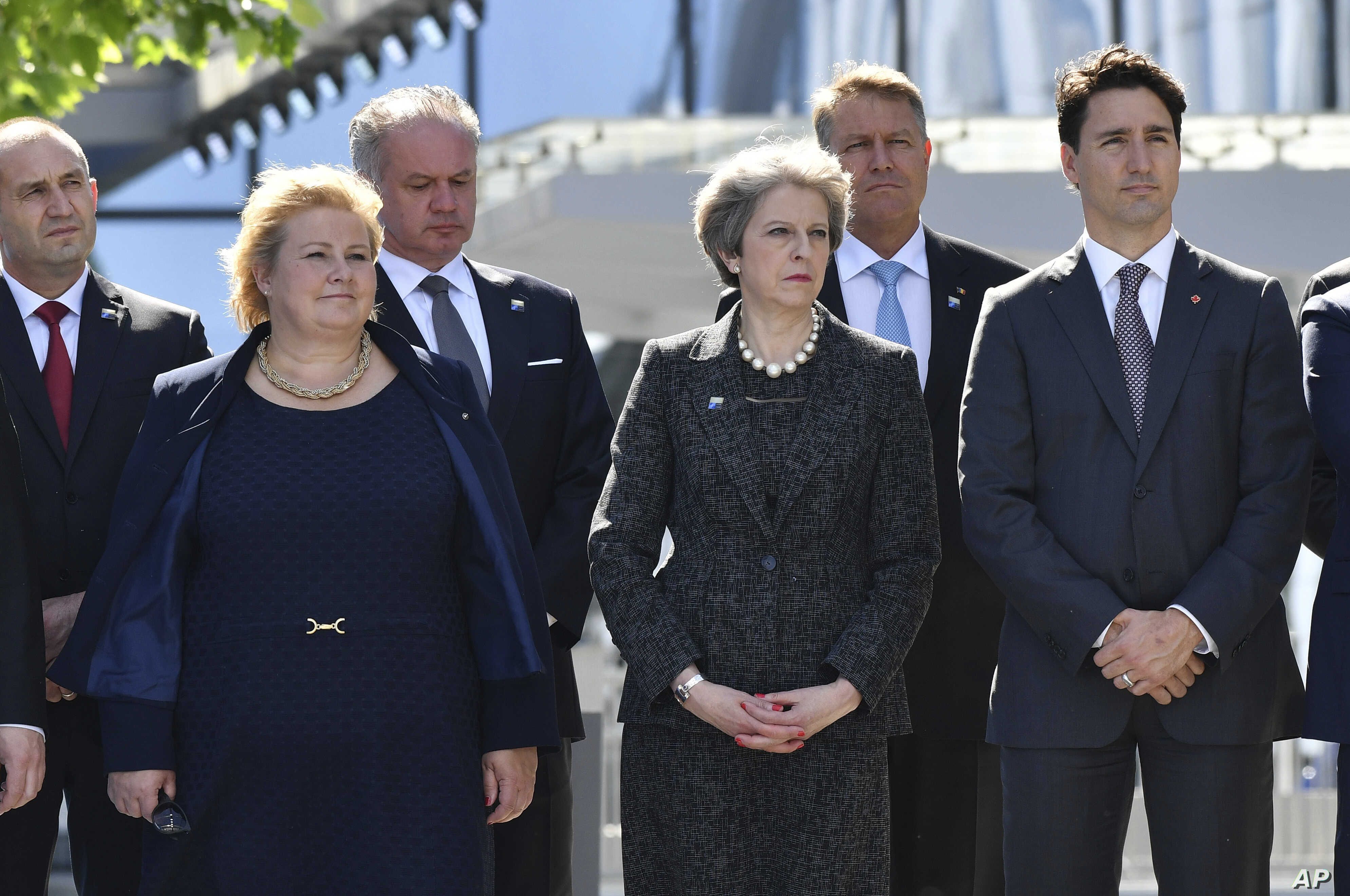Norway's PM Erna Solberg, British PM Theresa May, Canadian PM Justin Trudeau, from left, look on as U.S. President Donald Trump speaks during ceremony at the NATO summit in Brussels on May 25, 2017.