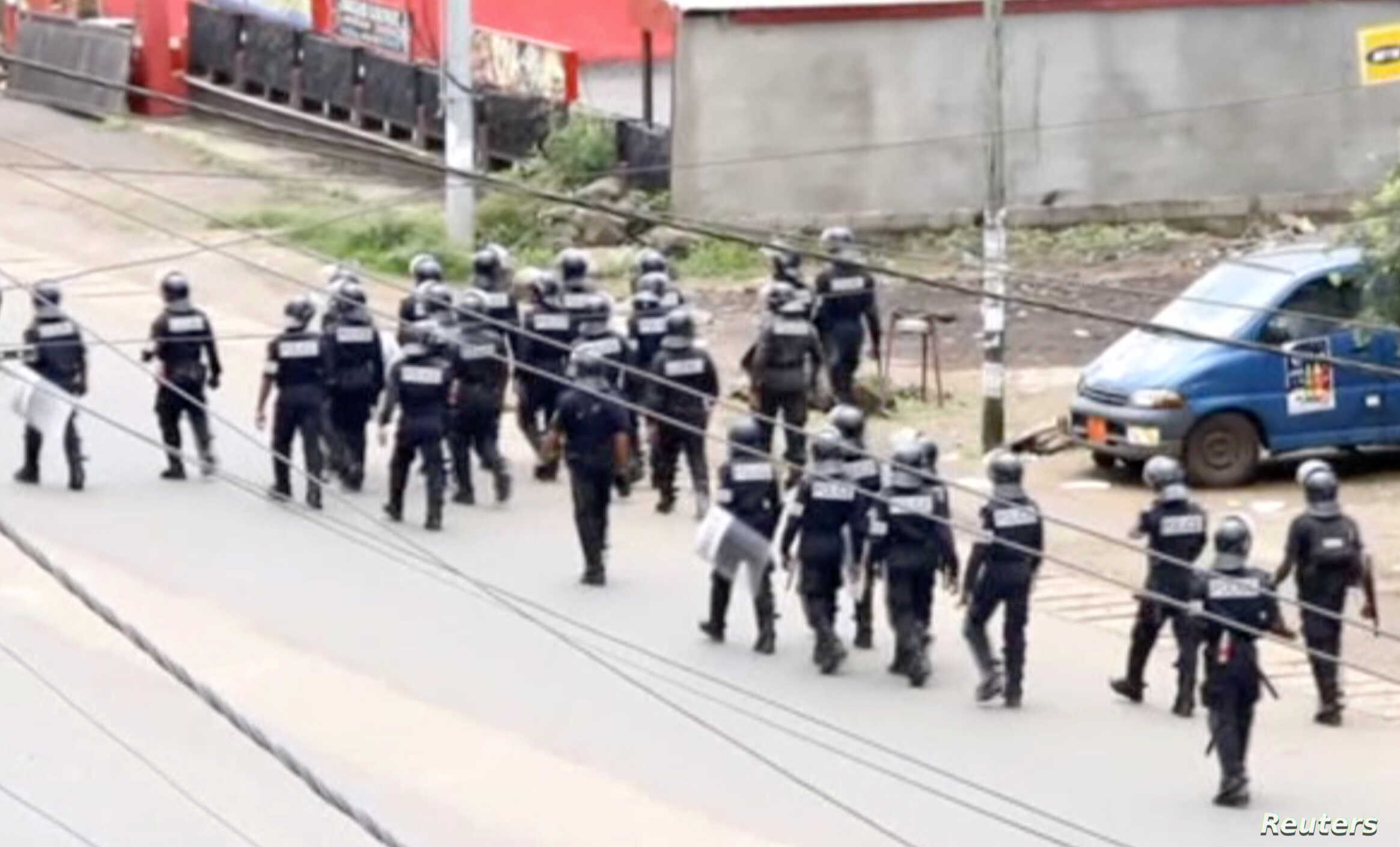 FILE - A still image taken from a video shows riot police walkin along a street in the English-speaking city of Buea, Cameroon, Oct. 1, 2017.