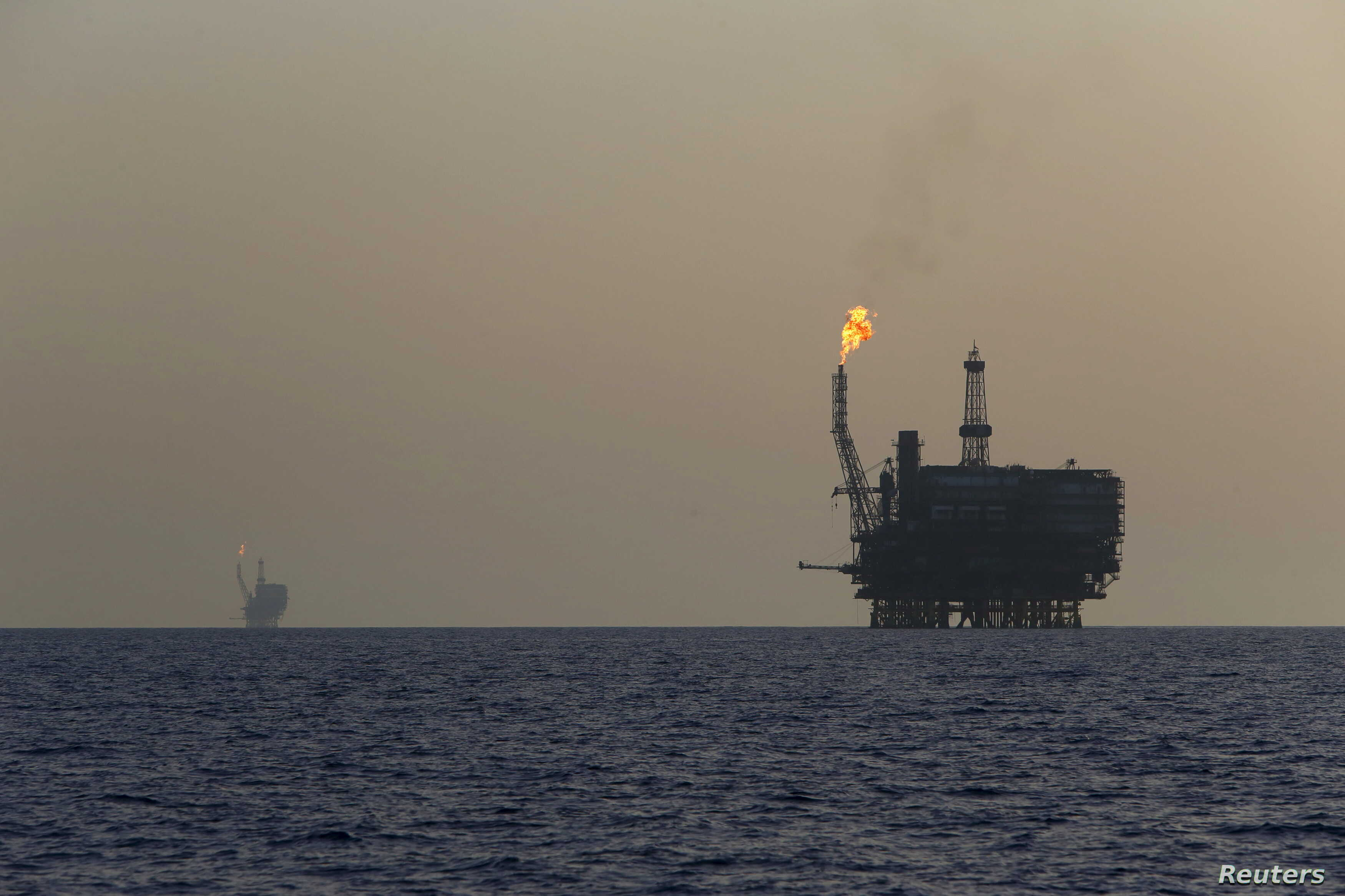FILE - Offshore oil platforms are seen at the Bouri Oil Field off the coast of Libya, Aug. 3, 2015.