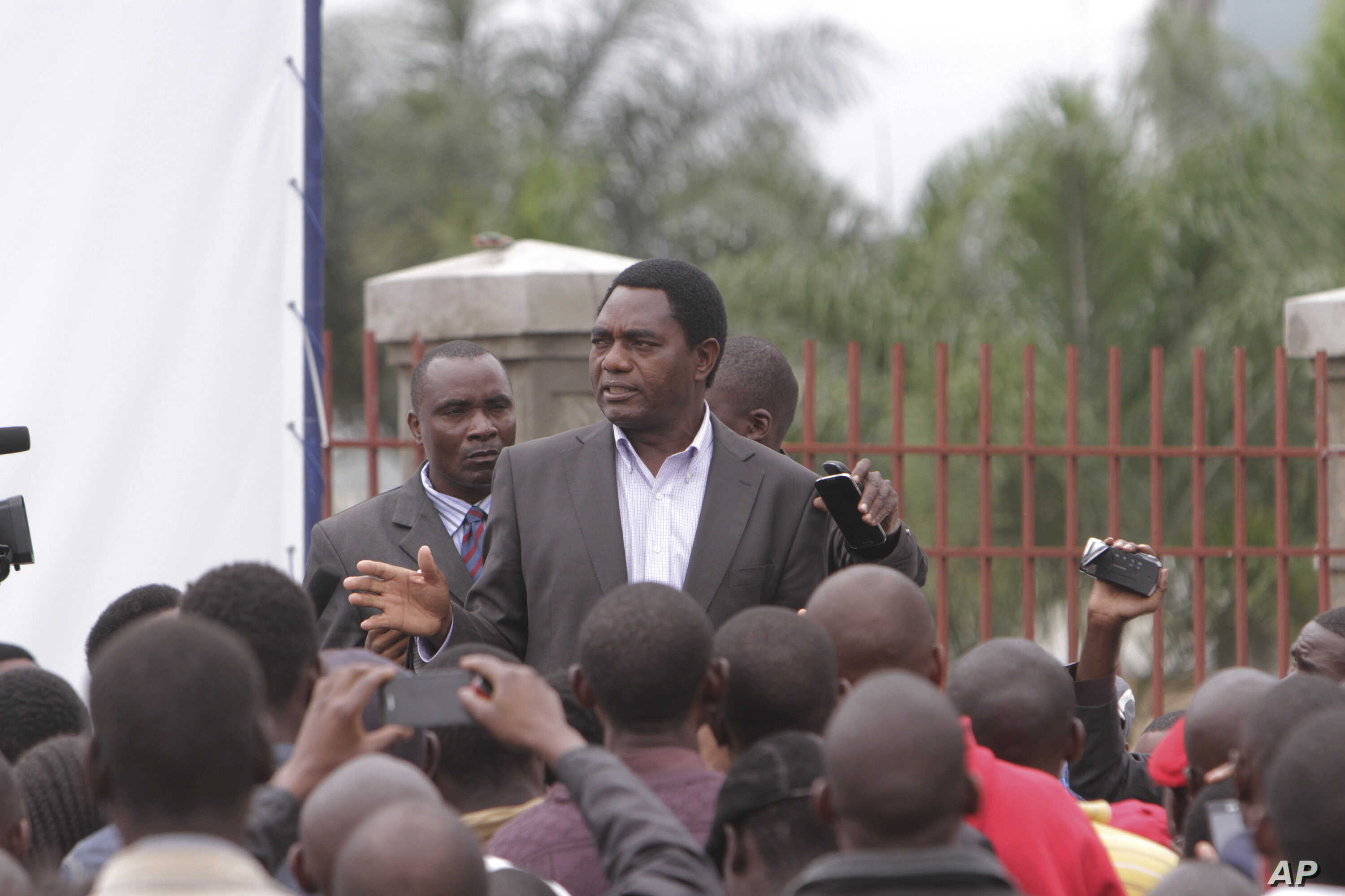FILE - Presidential candidate Hakainde Hichilema addresses supporters in Lusaka, Zambia, Wednesday, Jan, 21, 2015.