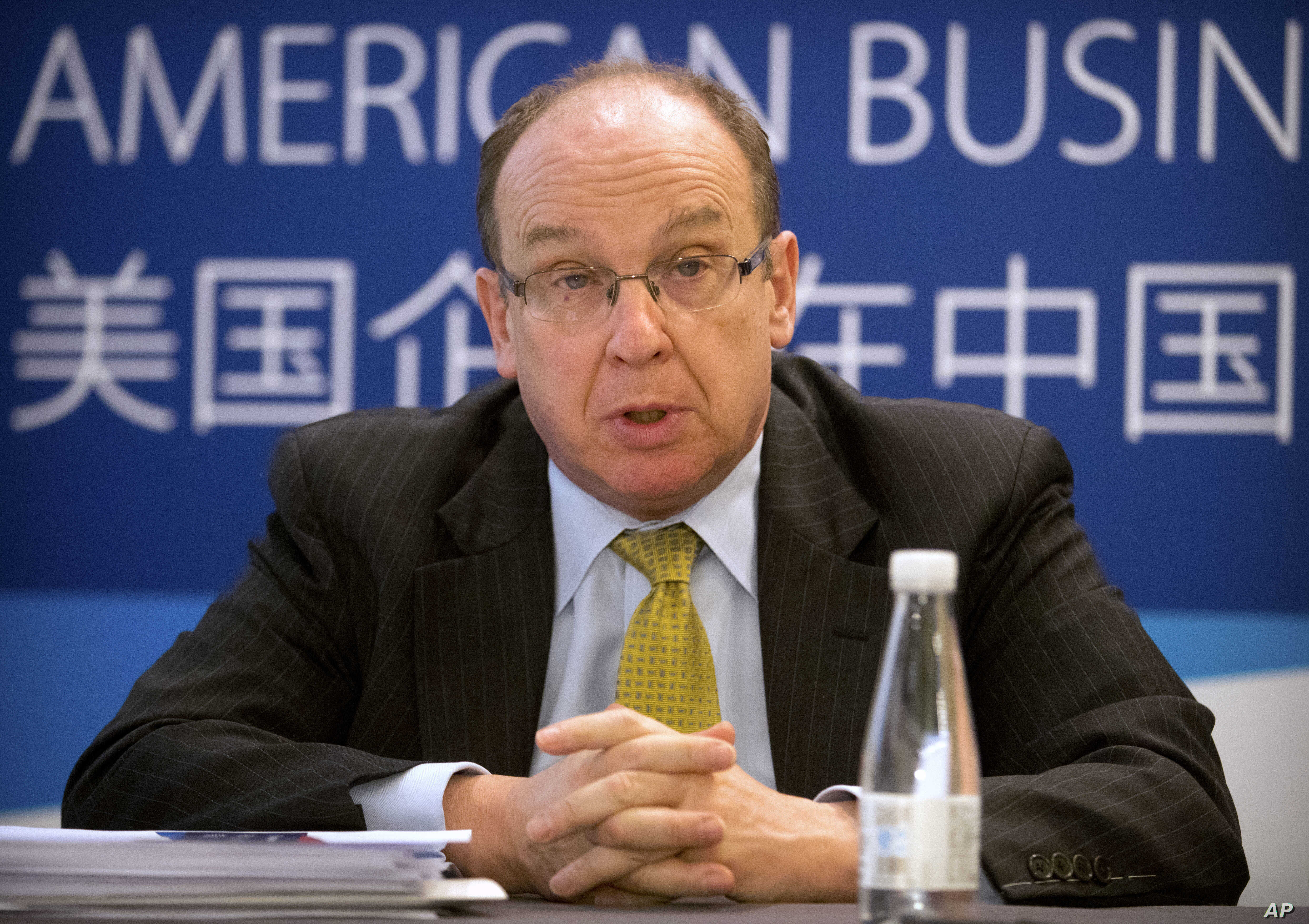FILE - Lester Ross, chairman of the Policy Committee of the American Chamber of Commerce in China, speaks during a press conference in Beijing for the chamber's annual report on American business in China, Apr. 18, 2017.