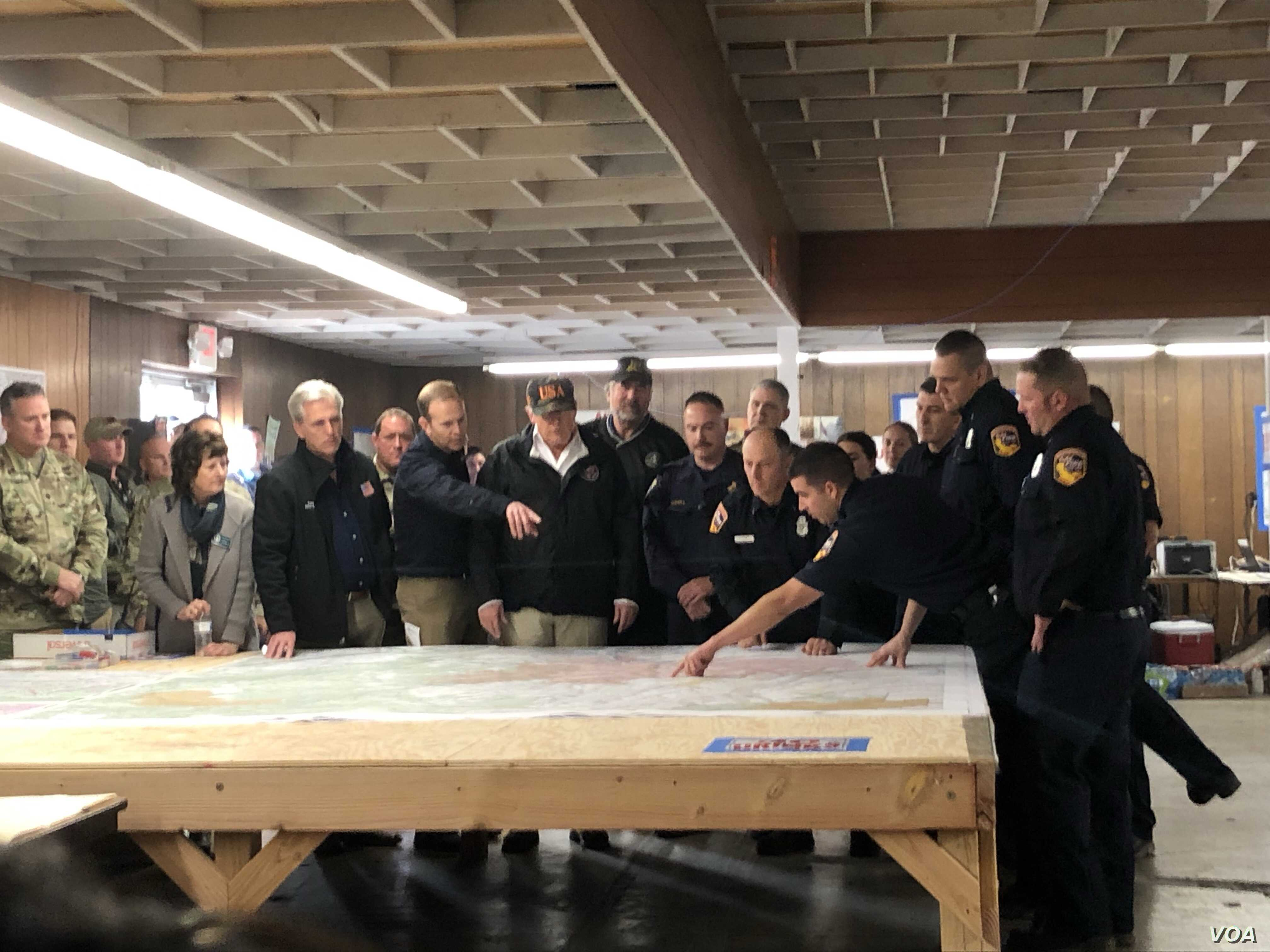California authorities show President Donald Trump where fire damage occurred in the Paradise, Calif., area, Nov. 17, 2018. At left is Paradise Mayor Jody Jones. At least 71 people died, more than 1,000 are missing and 9,700 homes were destroyed.