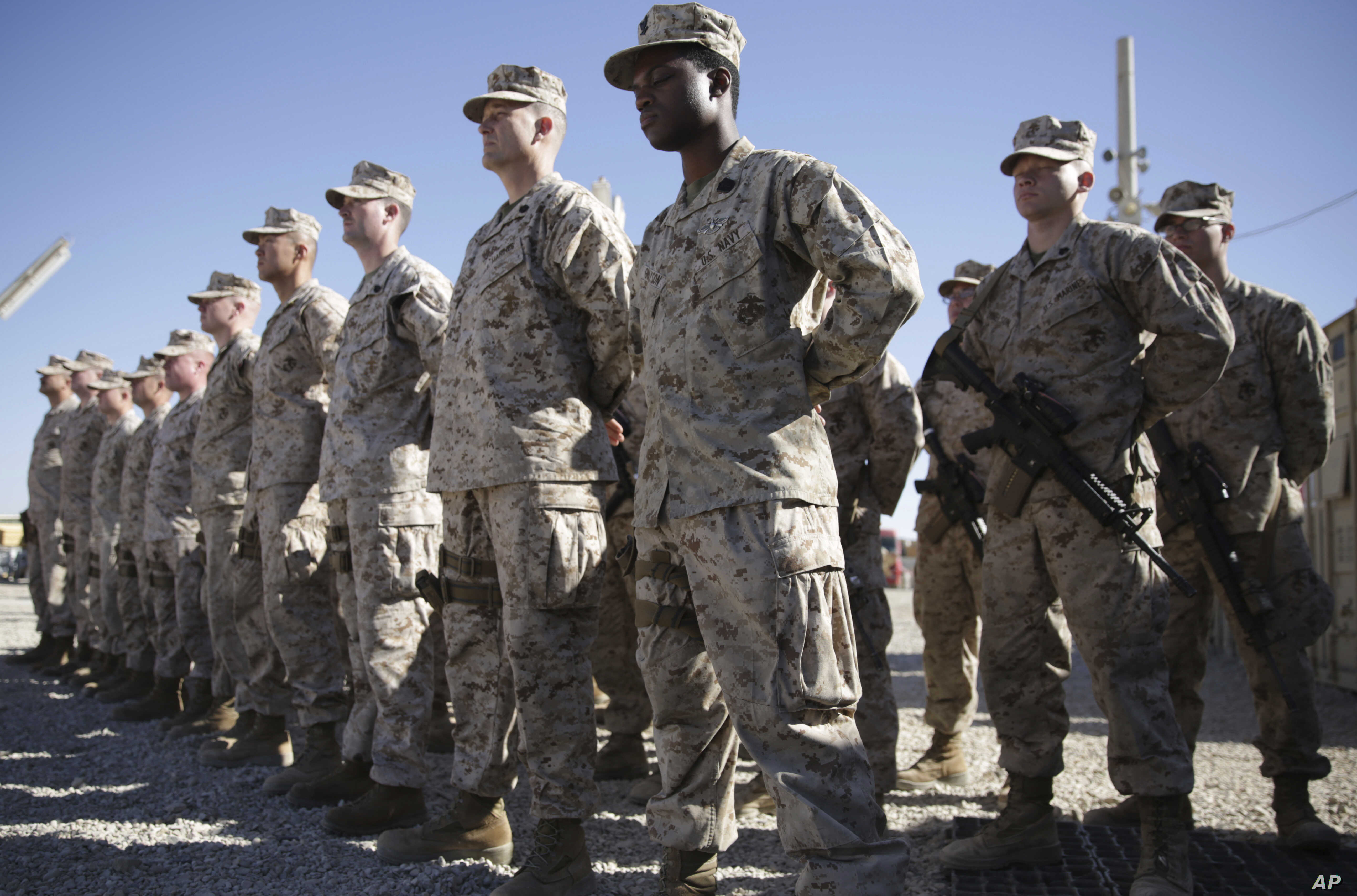 FILE - U.S. Marines stand guard during a change-of-command ceremony at Task Force Southwest military field in Shorab military camp of Helmand province, Afghanistan, Jan. 15, 2018.