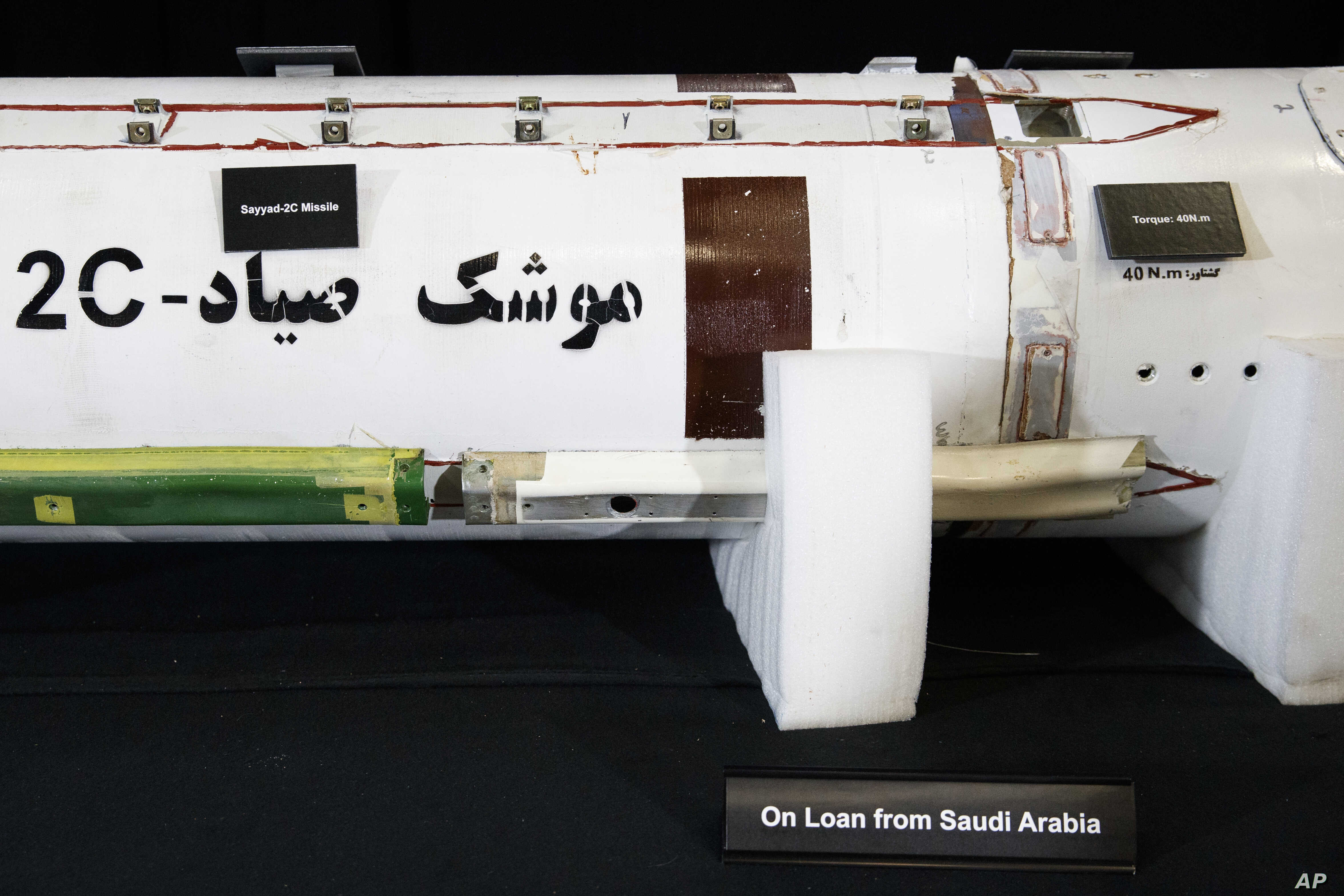 """Fragments of a  Surface to Air Missile (Sayyad 2C) is displayed with a sign that reads """"On Loan Form Saudi Arabia"""" at the Iranian Materiel Display (IMD) at Joint Base Anacostia-Bolling, in Washington, Nov. 29, 2018."""