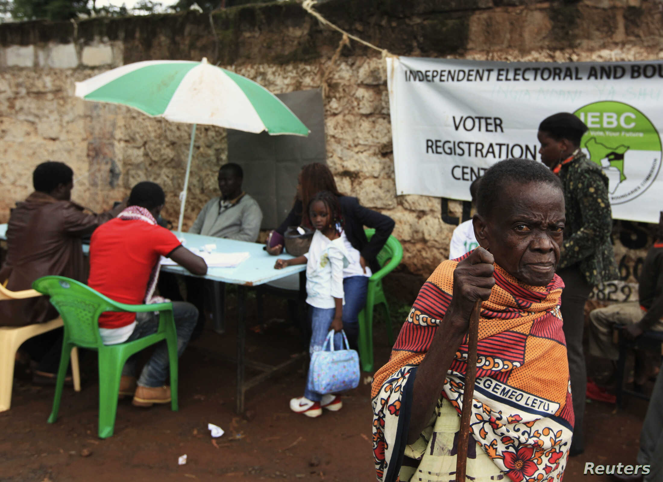 FILE - A Kenyan woman leaves a voter registration center on the last day of the exercise in Nairobi.