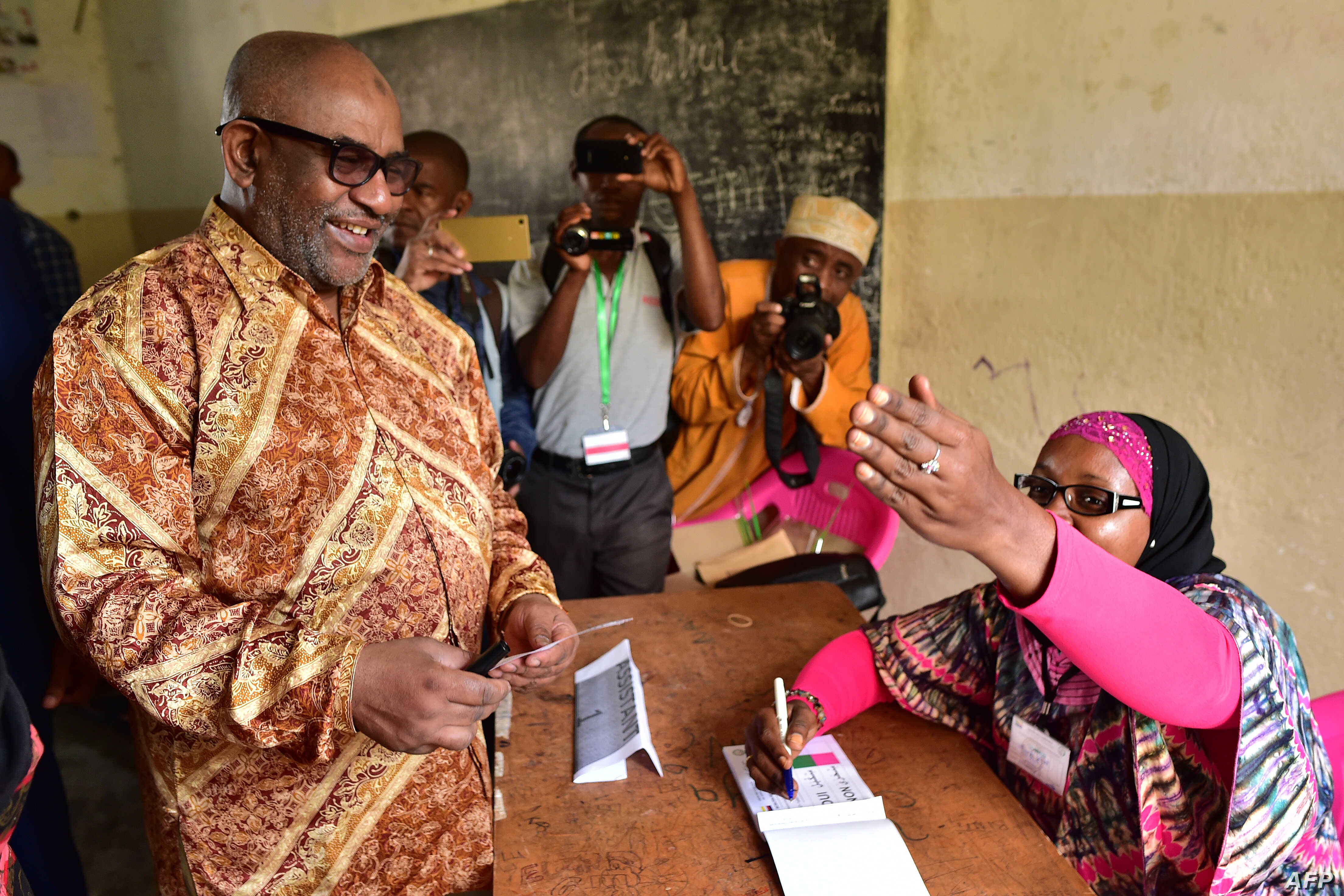 Comoros' President Azali Assoumani arrives at a polling station to cast his ballot during a constitutional referendum, July 30, 2018, outside Moroni capital of the Comoros archipelago off Africa's ea