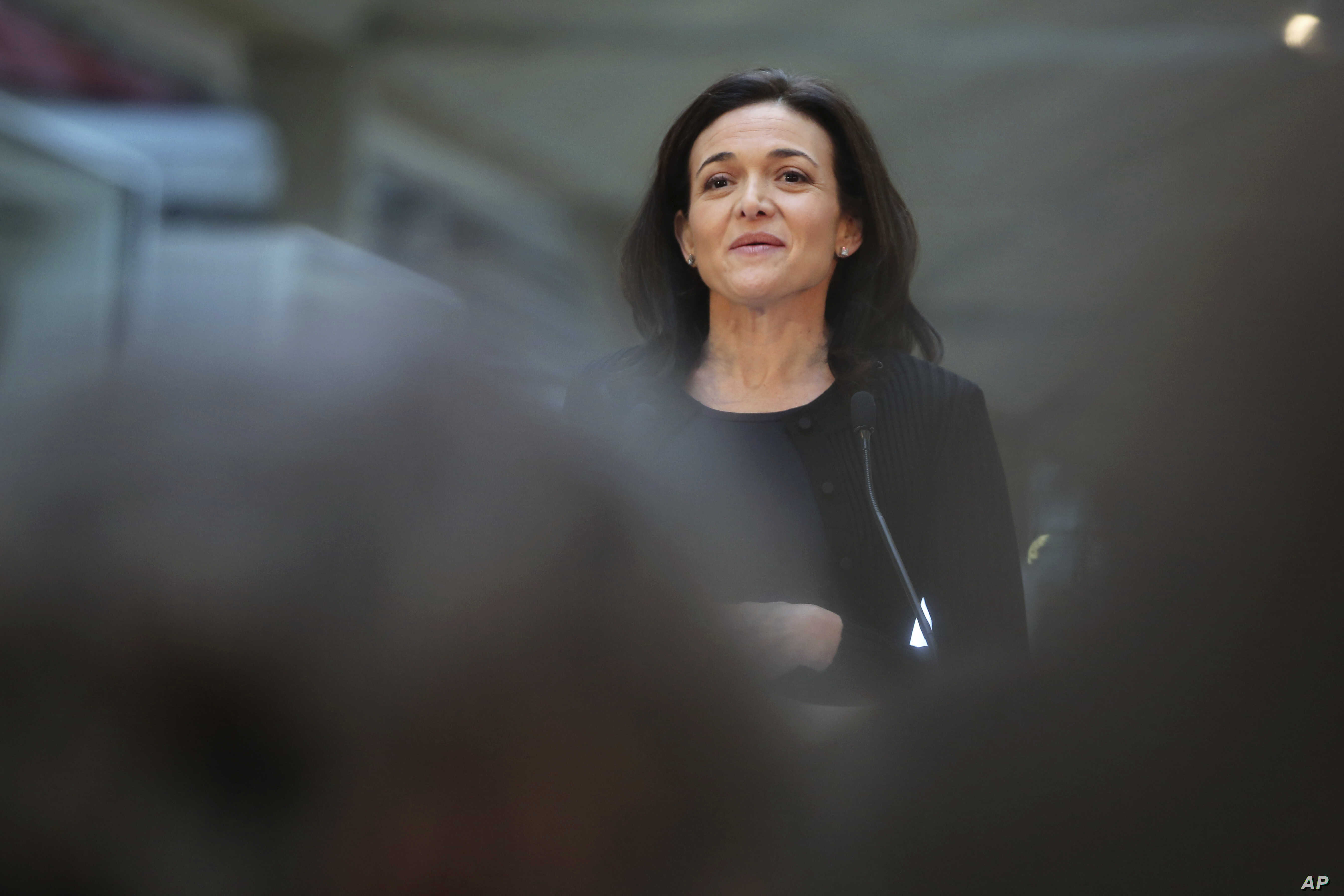 FILE - Chief Operating Officer of Facebook, Sheryl Sandberg, delivers a speech during the visit of a start-up companies in Paris, France, Jan. 17, 2017.