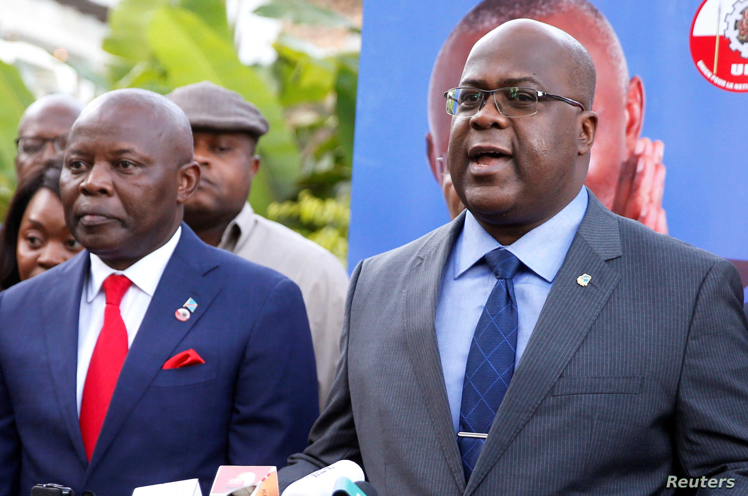 FILE - Felix Tshisekedi (R), leader of Congolese main opposition, the Union for Democracy and Social Progress (UDPS) party, flanked by Vital Kamerhe, leader of the (UNC) party, address a news conference in Nairobi, Kenya, Nov. 23, 2018.