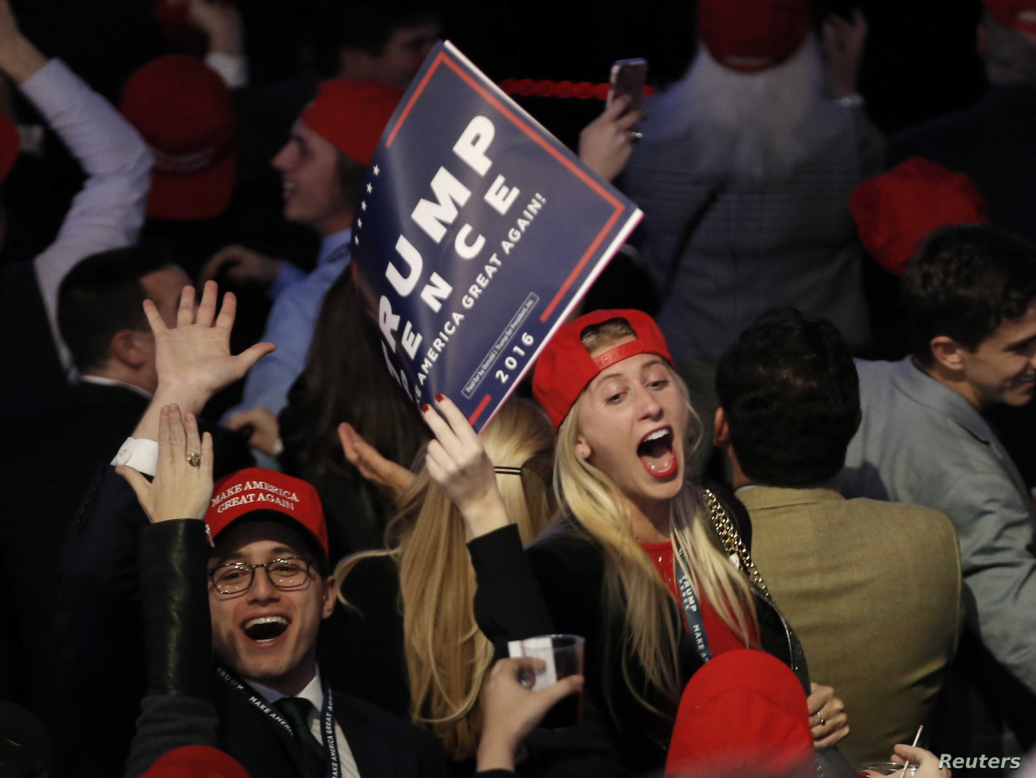 Trump supporters celebrate as they watch election returns come in at Republican presidential nominee Donald Trump's election night rally in Manhattan, New York, Nov. 8, 2016.