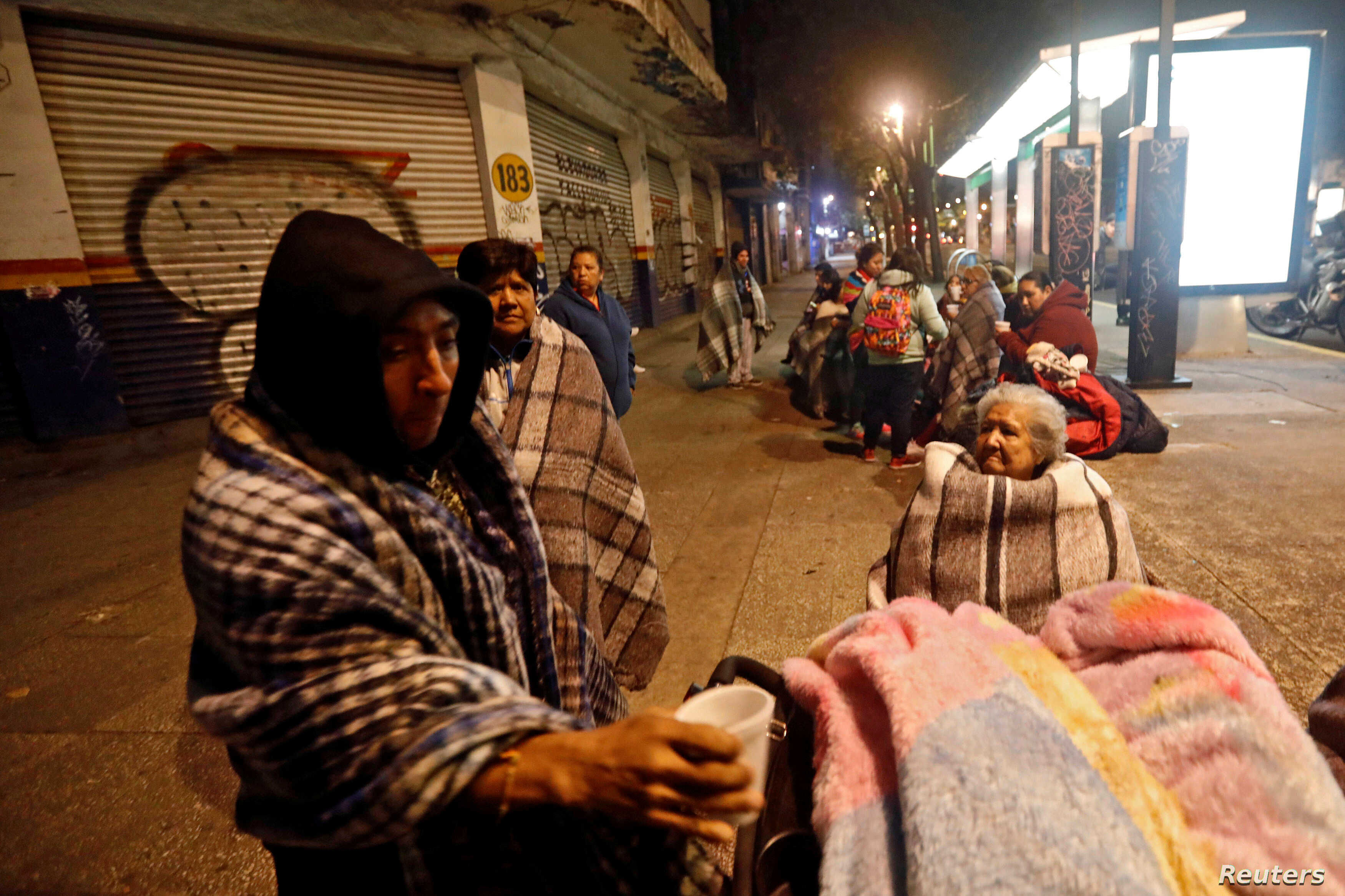 People gather on a street after an earthquake hit Mexico City, Mexico, Sept. 8, 2017.