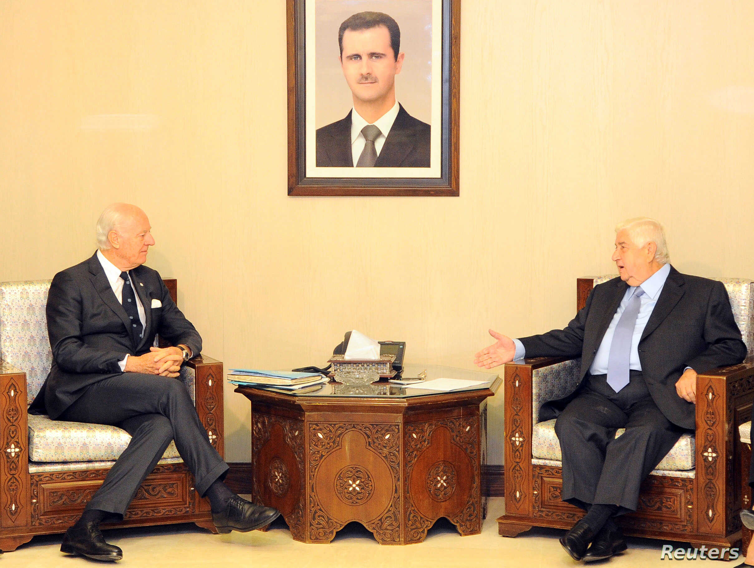 Syrian Foreign Minister Walid al-Muallem meets with U.N. mediator for Syria Staffan de Mistura in Damascus, Syria, in this handout picture provided by SANA, Nov. 20, 2016.