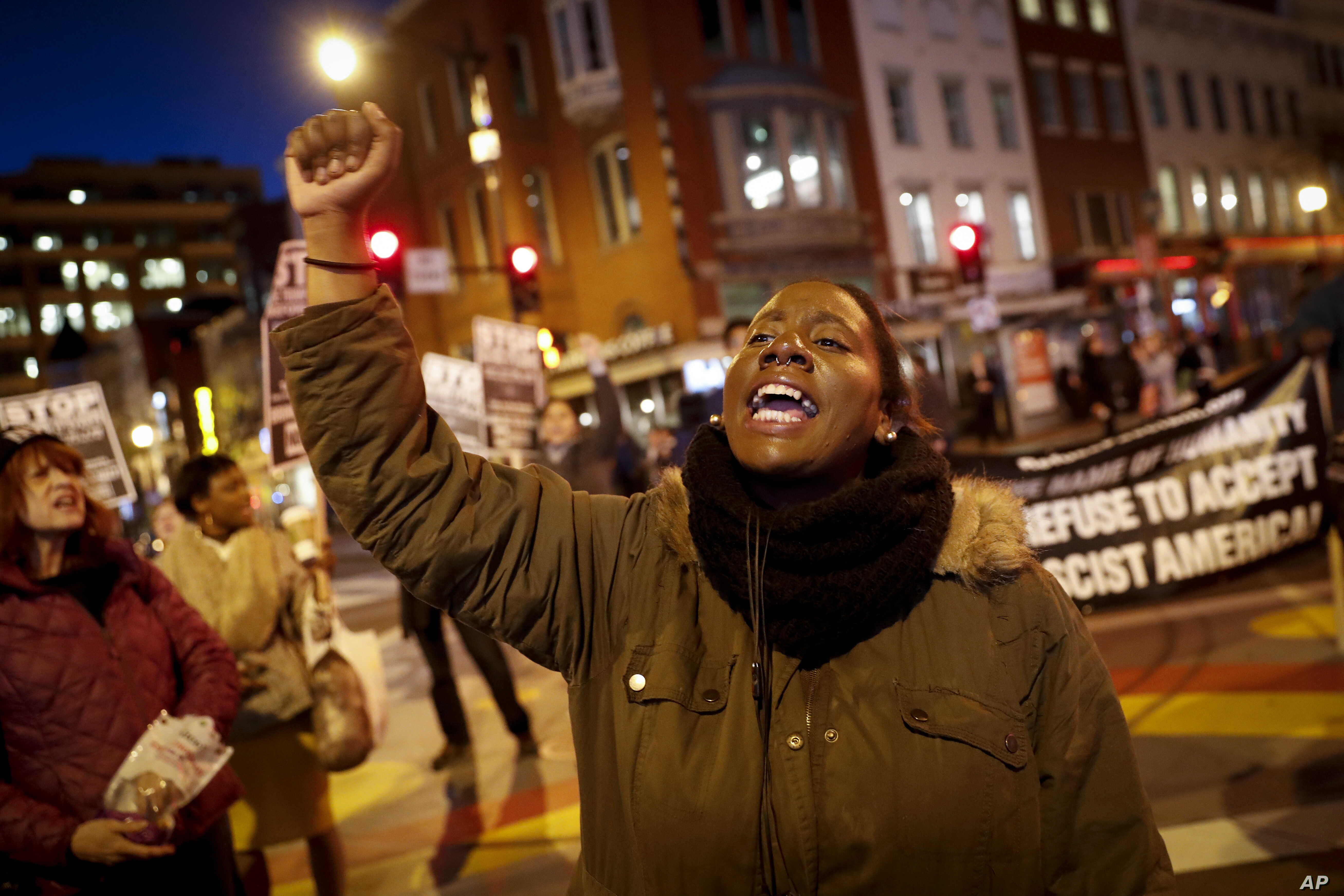 A protester yells as others gather for a march on the Capitol Building, Jan. 18, 2017, in Washington.