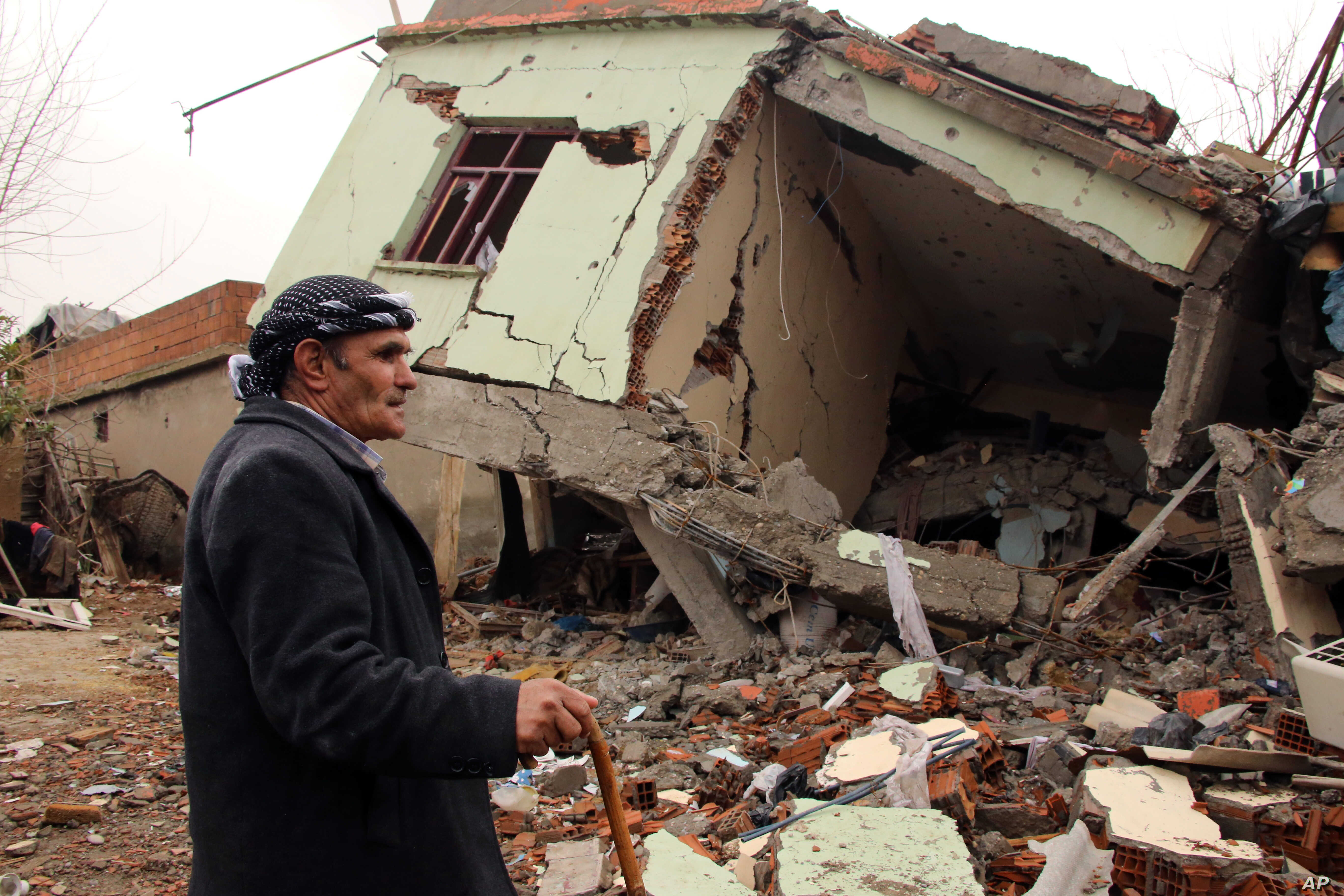 A resident walks on the rubble of a destroyed house in the mostly-Kurdish town of Silopi, Turkey, Jan. 19, 2016. Turkey's president has ruled out any further peace efforts with Kurdish rebels.