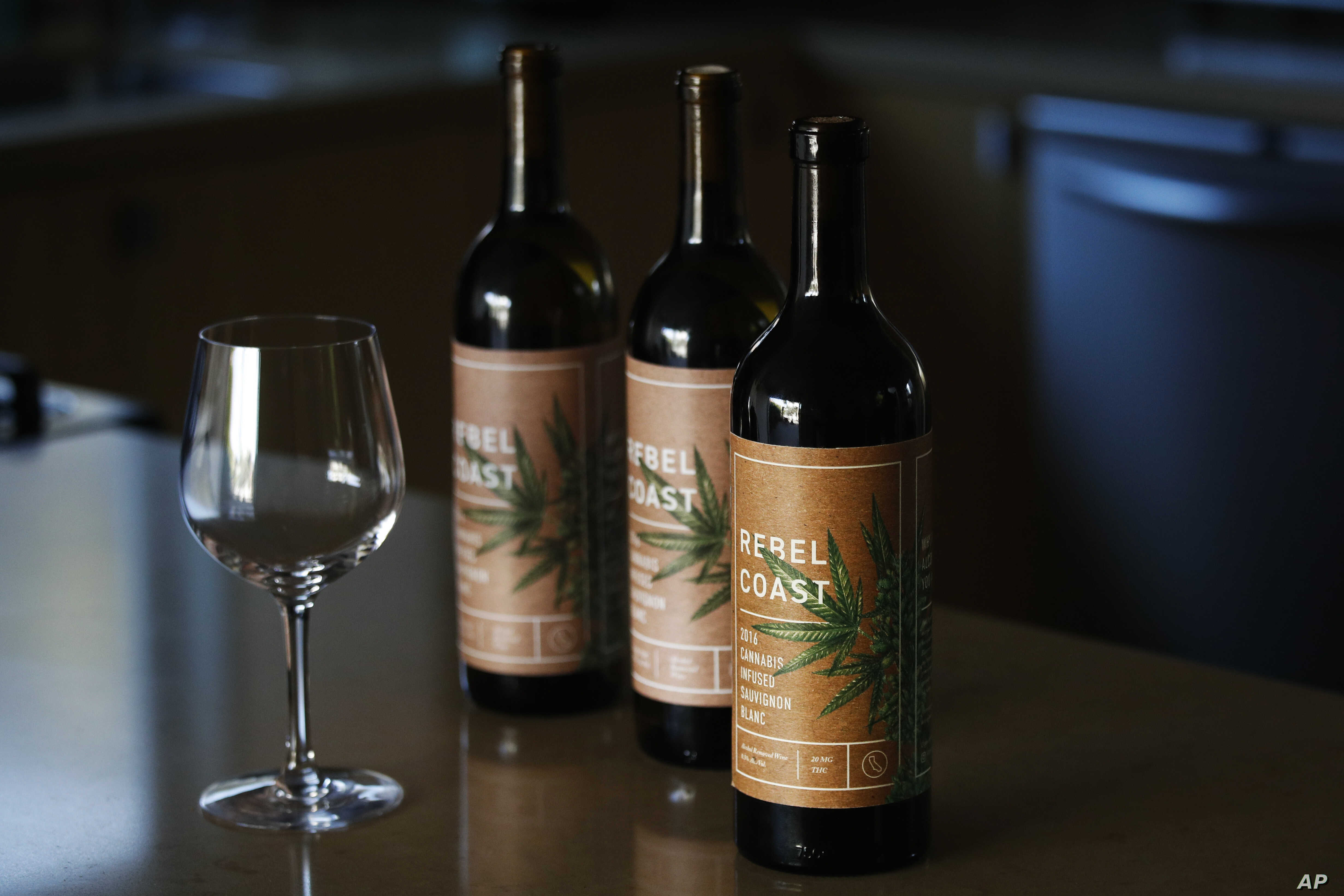 In this Dec. 22, 2017, photo, three bottles of Rebel Coast Winery's cannabis-infused wine is displayed in Los Angeles.