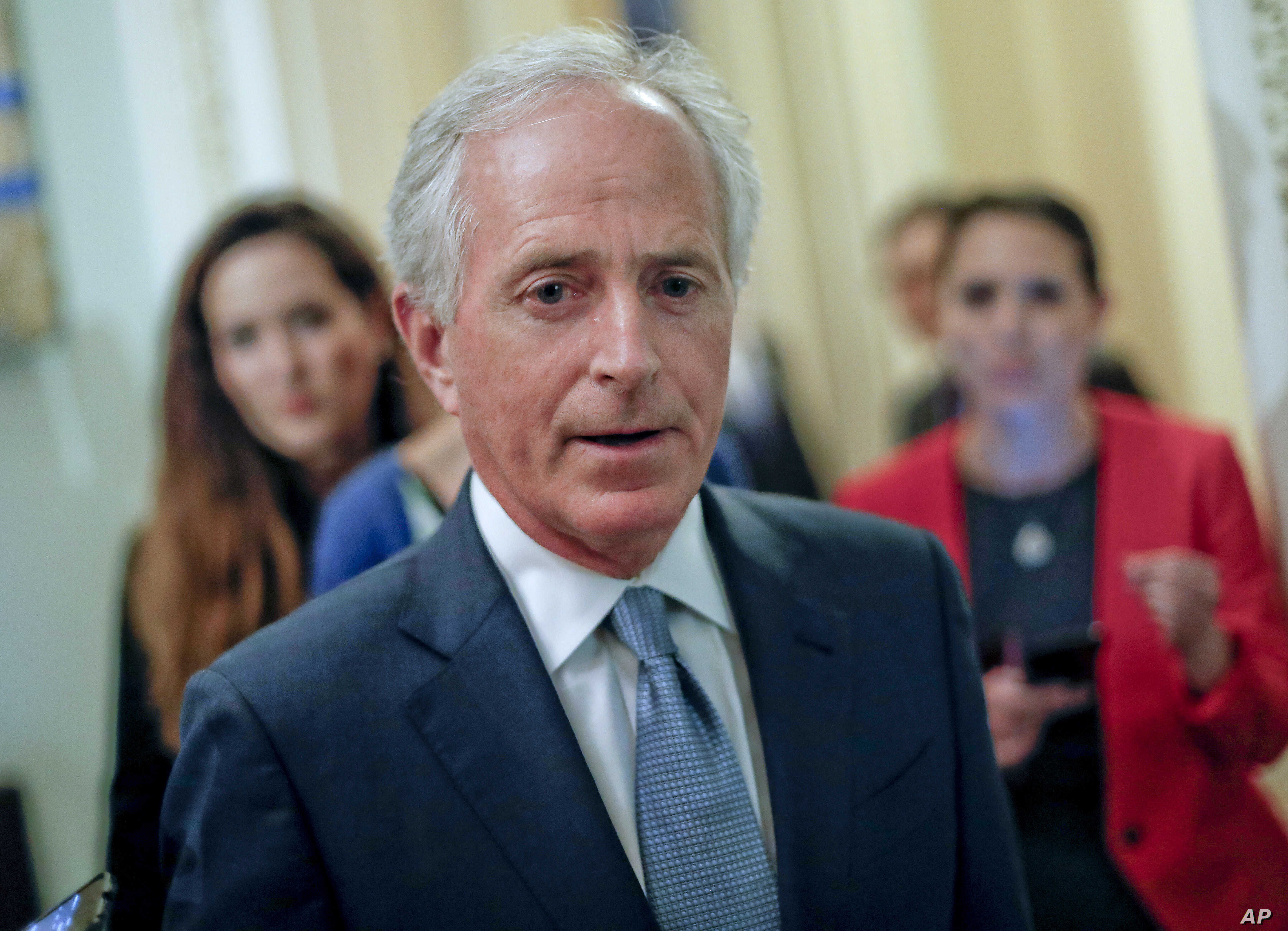 FILE - Sen. Bob Corker, R-Tenn., speaks to members of the media as he arrives for a luncheon with Vice President Mike Pence, on Capitol Hill in Washington, May 2, 2017. A package of new Russia sanctions is heading toward overwhelming approval by Cong...