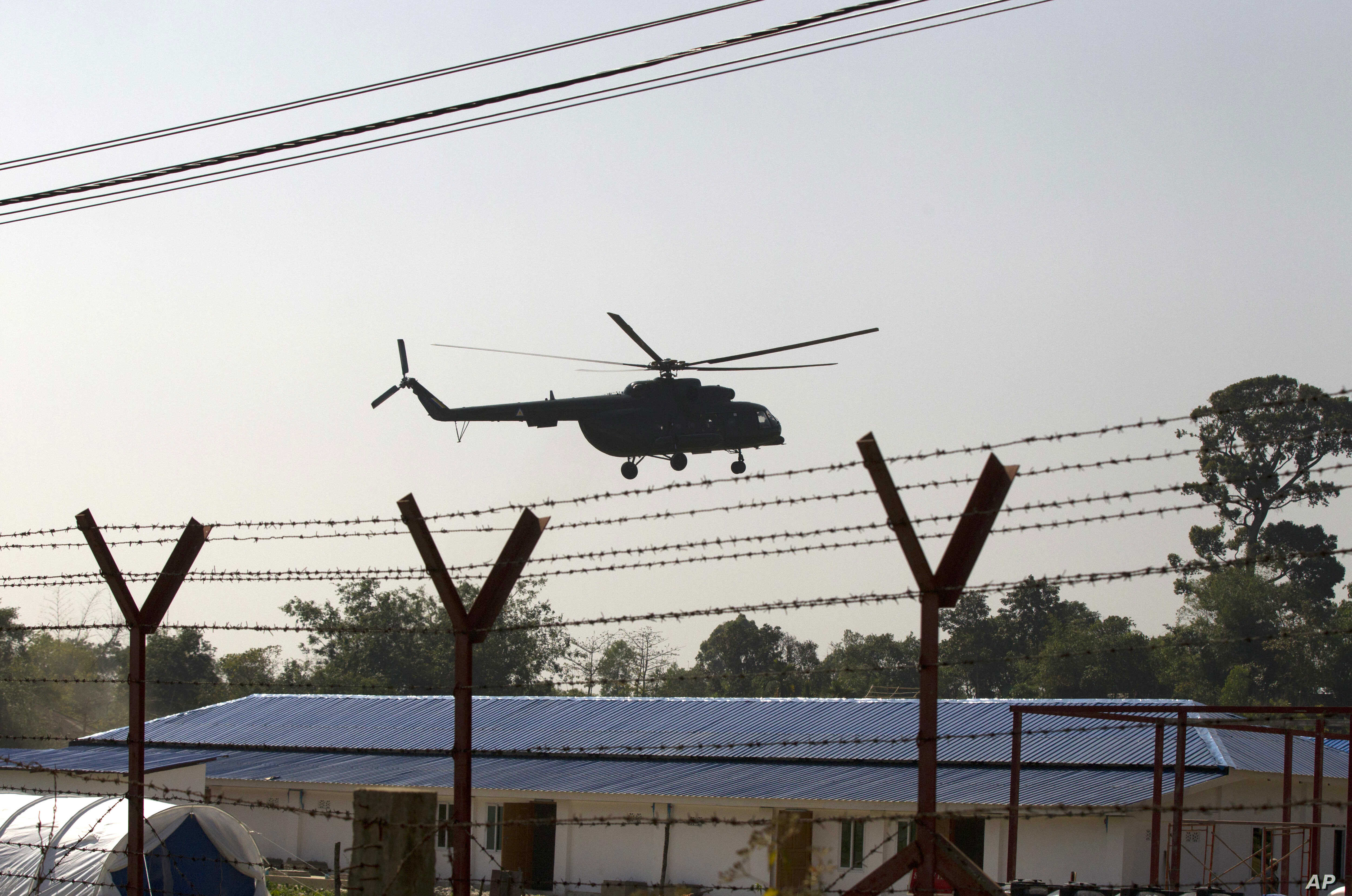 A helicopter carrying an advisory commission lands near newly-built repatriation camps prepared for Rohingya refugees expected to be returning from Bangladesh, Jan. 24, 2018, in Taungpyo, Myanmar.