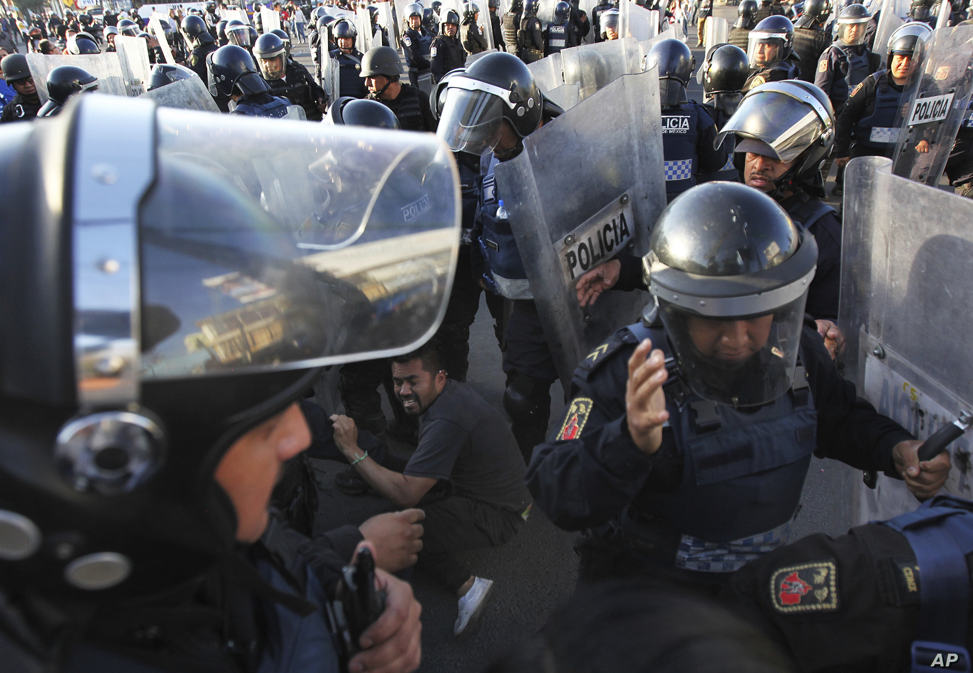 Police forcibly remove demonstrators who blocked a main road for about an hour as they protest hikes in gas prices in Mexico City, Jan. 4, 2017. Protesters have blocked highways, distribution terminals and gas stations since fuel prices went up by a...