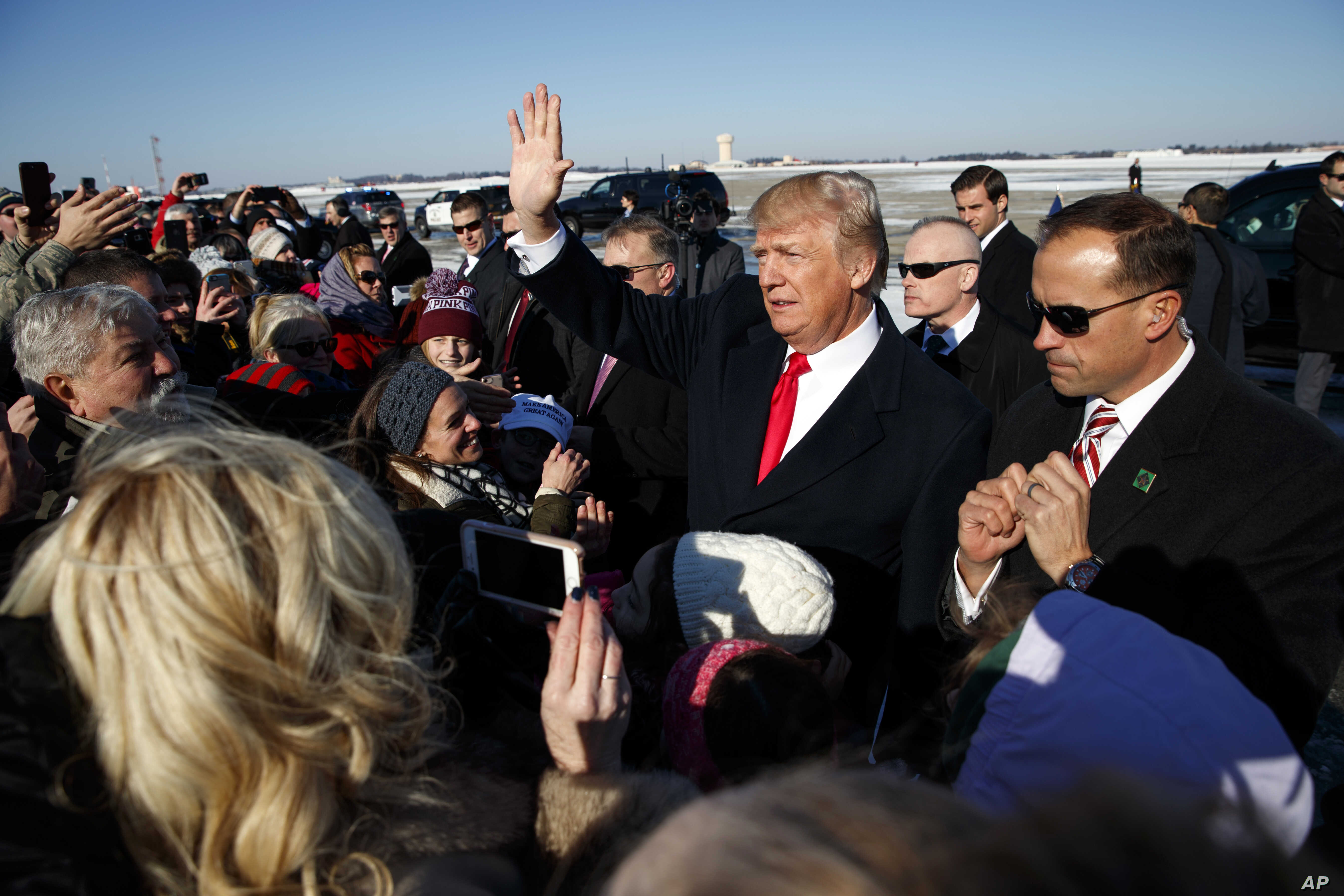 President Donald Trump waves to supporters after arriving at Pittsburgh International Airport, Jan. 18, 2018, in Pittsburgh.
