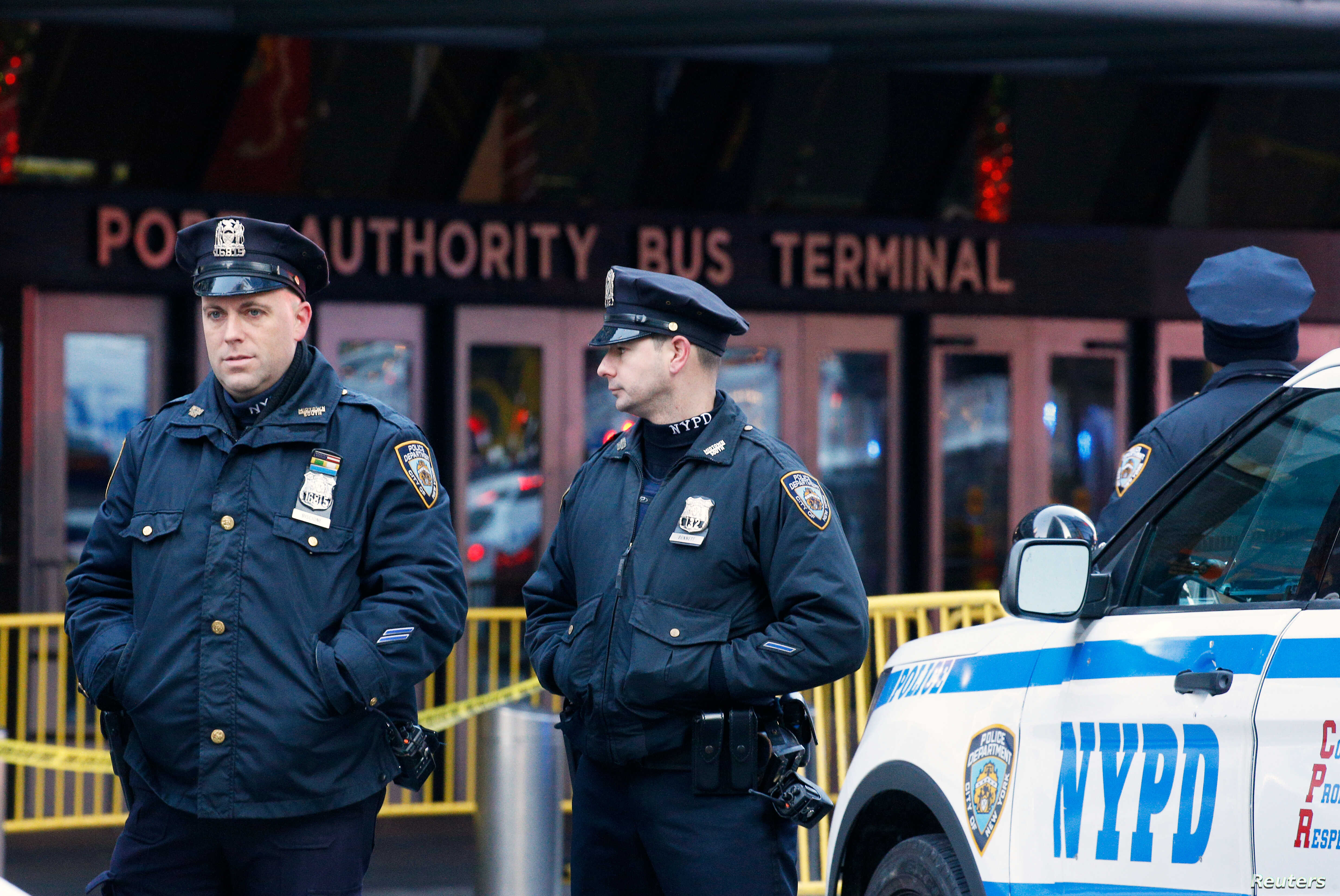 Police officers stand outside the New York Port Authority Bus Terminal in New York City, U.S. Dec. 11, 2017 after reports of an explosion.