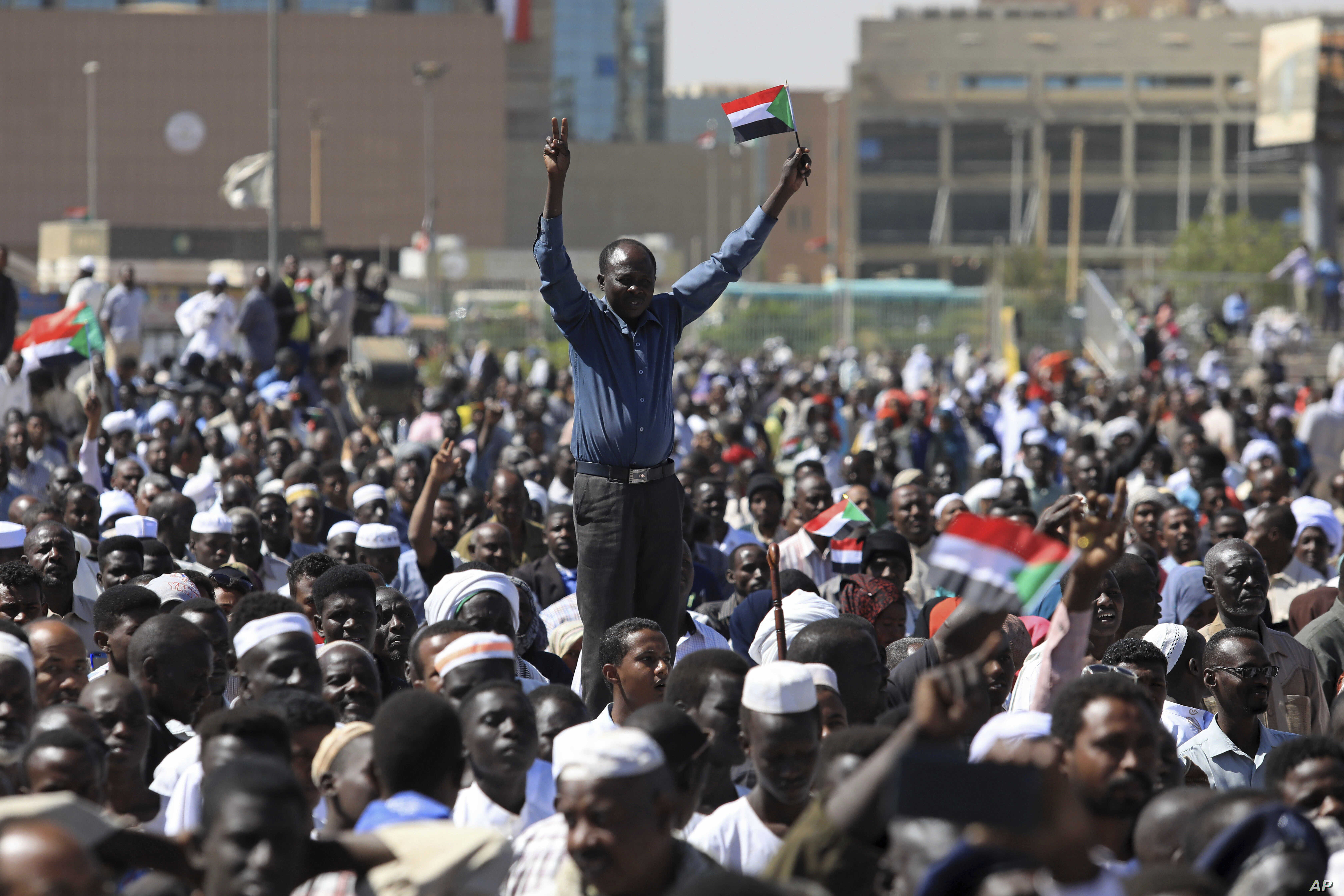 Supporters of Sudan's President Omar al-Bashir attend a pro-government rally in Khartoum, Sudan, Wednesday, Jan. 9, 2019.
