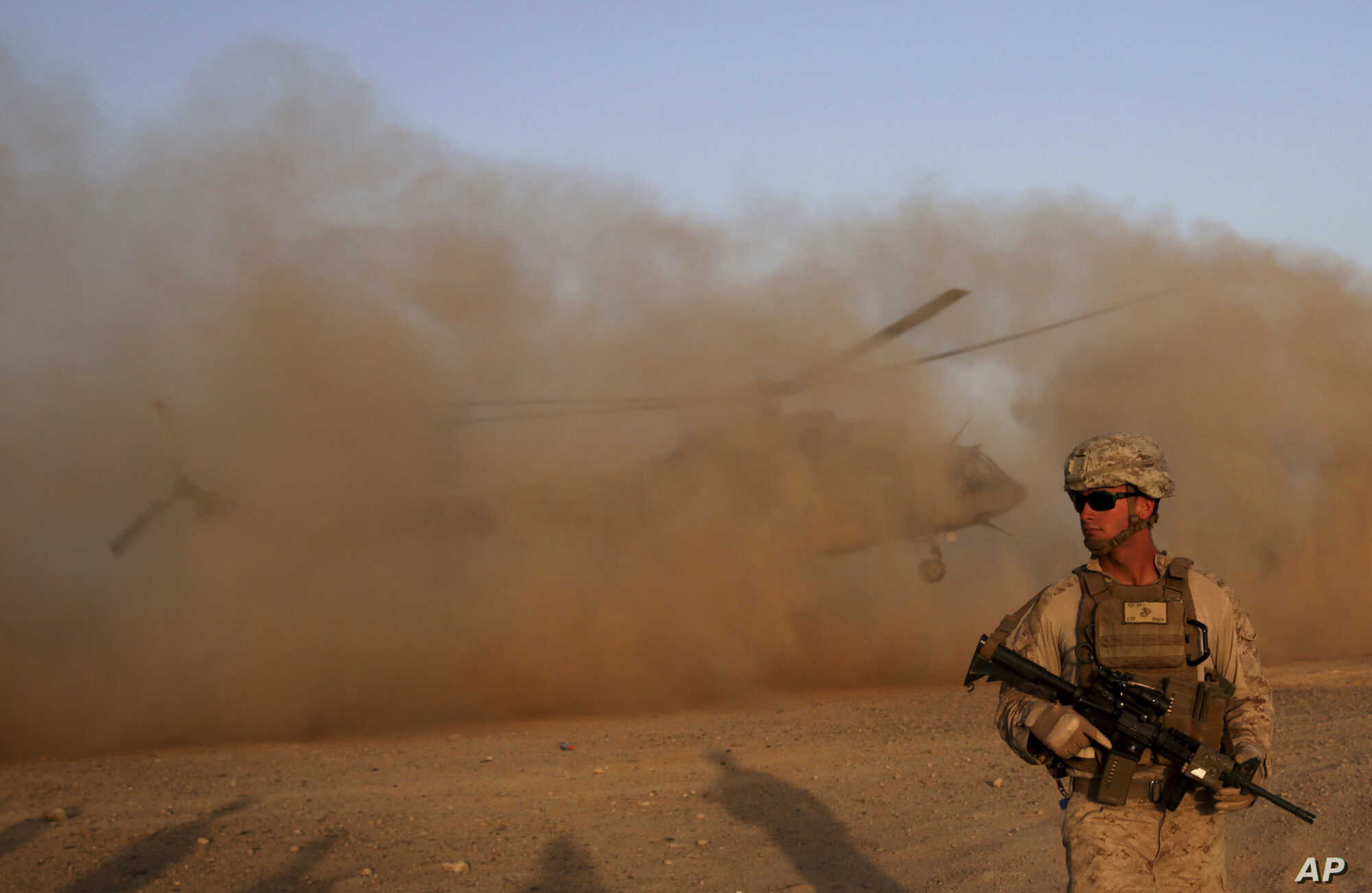 A U.S. Marine takes part during a training session for Afghan army commandos in Shorab military camp in Helmand province, Afghanistan, Aug. 27, 2017.