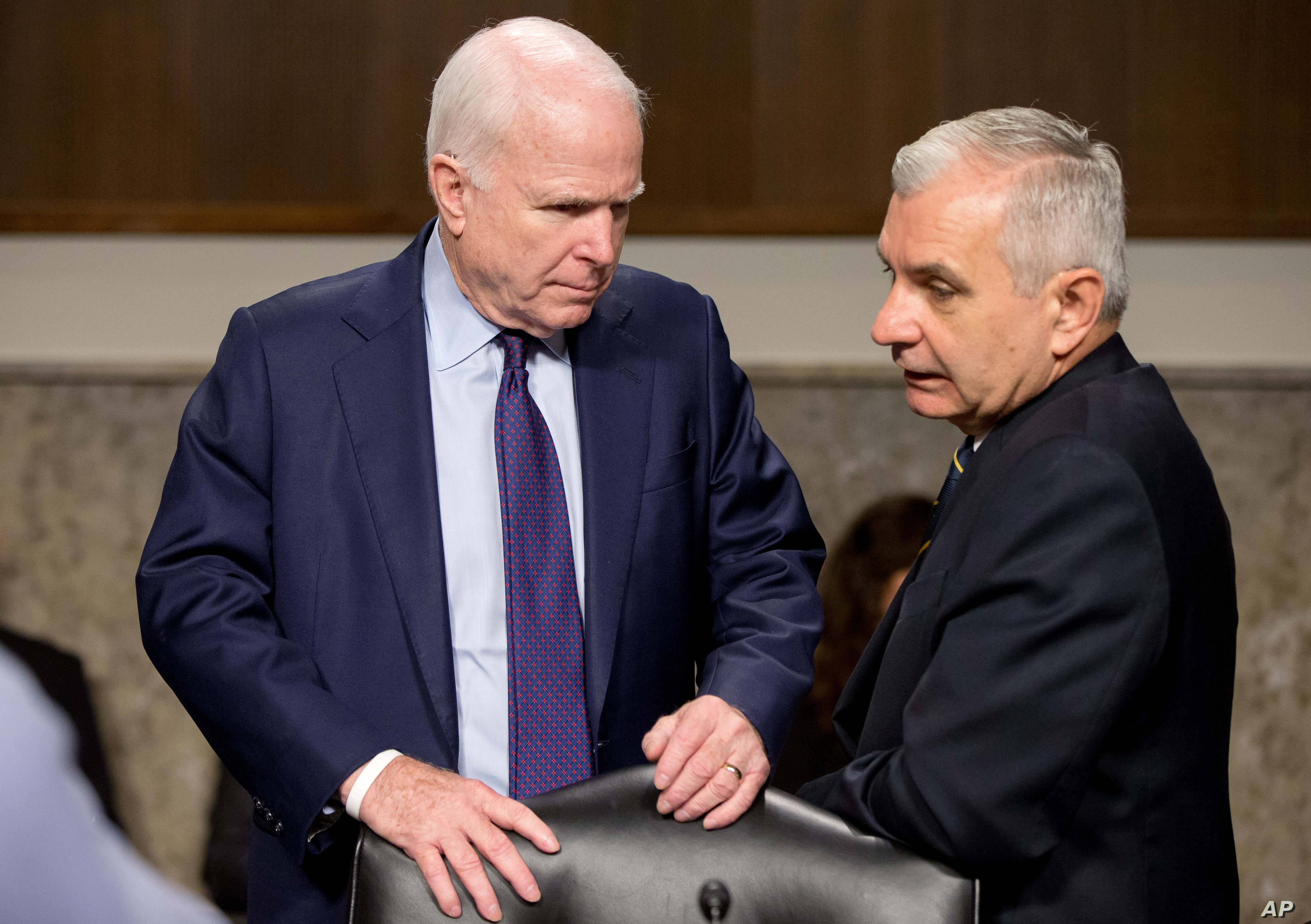 Senate Armed Service Committee Chairman John McCain, R-Ariz., left, talks with committee's ranking member Jack Reed, D-R.I., on Capitol Hill in Washington, July 29, 2015.