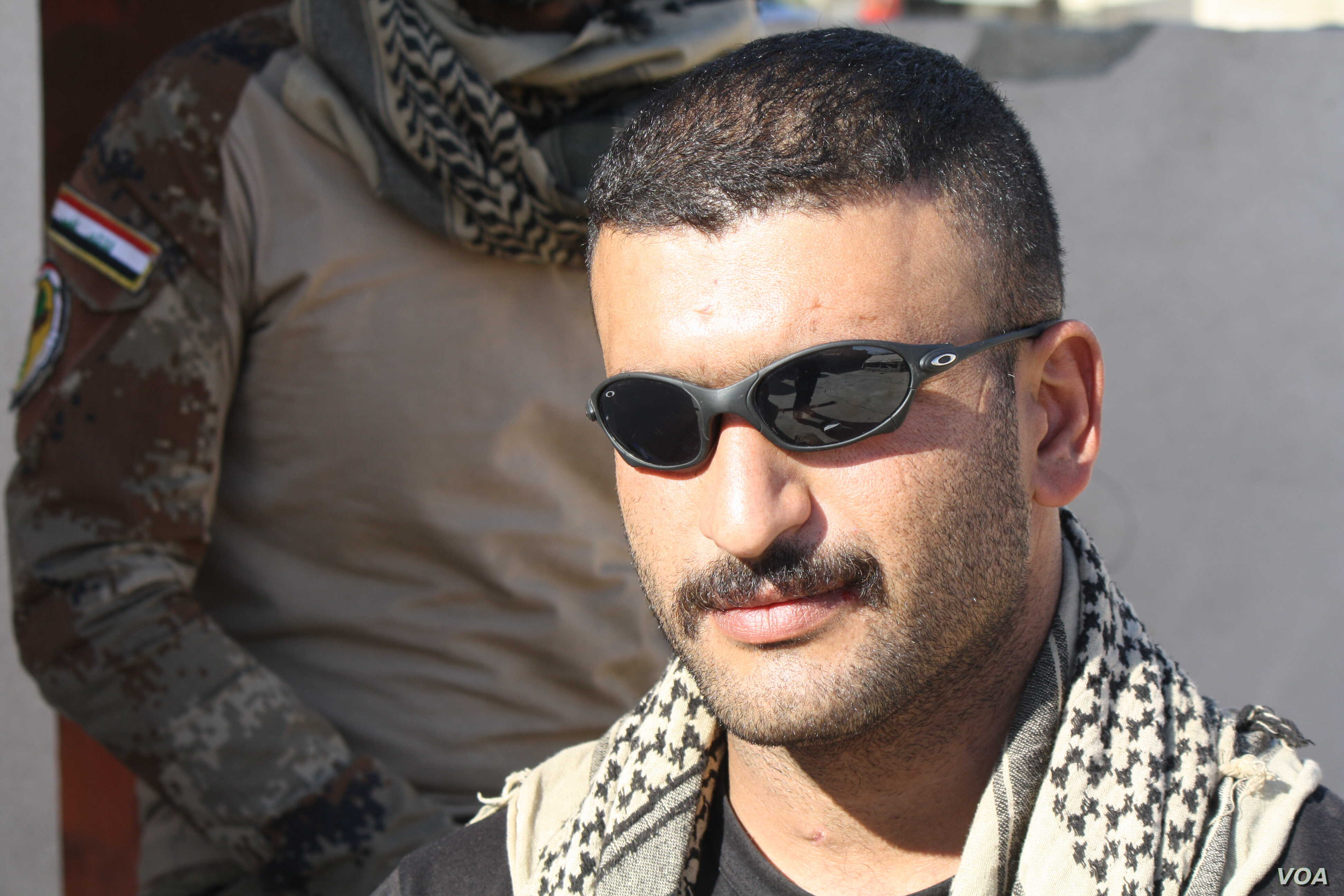 Iraqi Army Captain Raad Qasim says his battalion is moving forward slowly, trying to avoid killing civilians sometimes handcuffed to militants as they retreat on Nov. 19, 2016 in Mosul, Iraq.