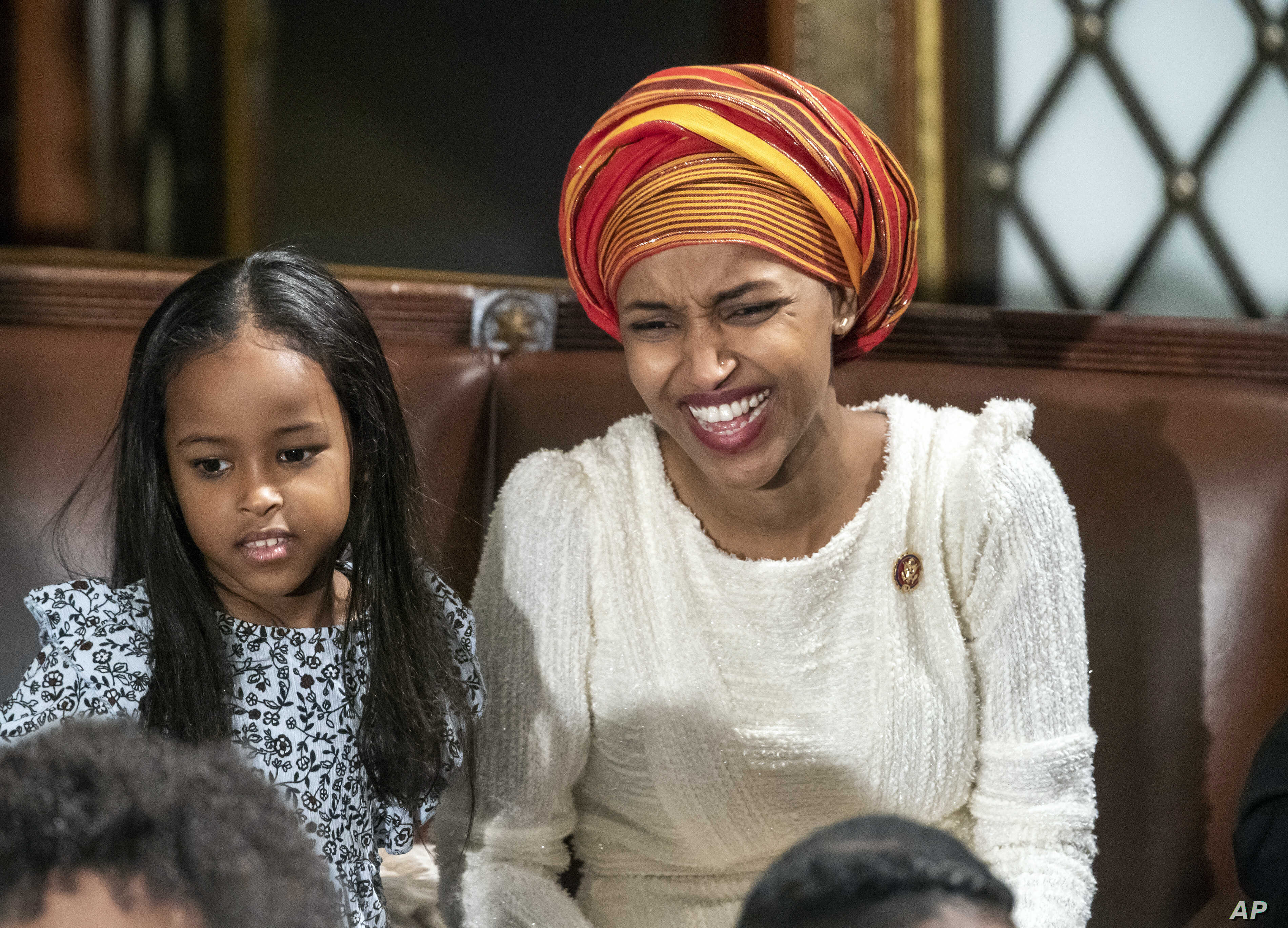 Rep. Ilhan Omar, a freshman Democrat representing Minnesota's 5th Congressional District, smiles as the House of Representatives assembles for the first day of the 116th Congress at the Capitol in Washington, Jan. 3, 2019.