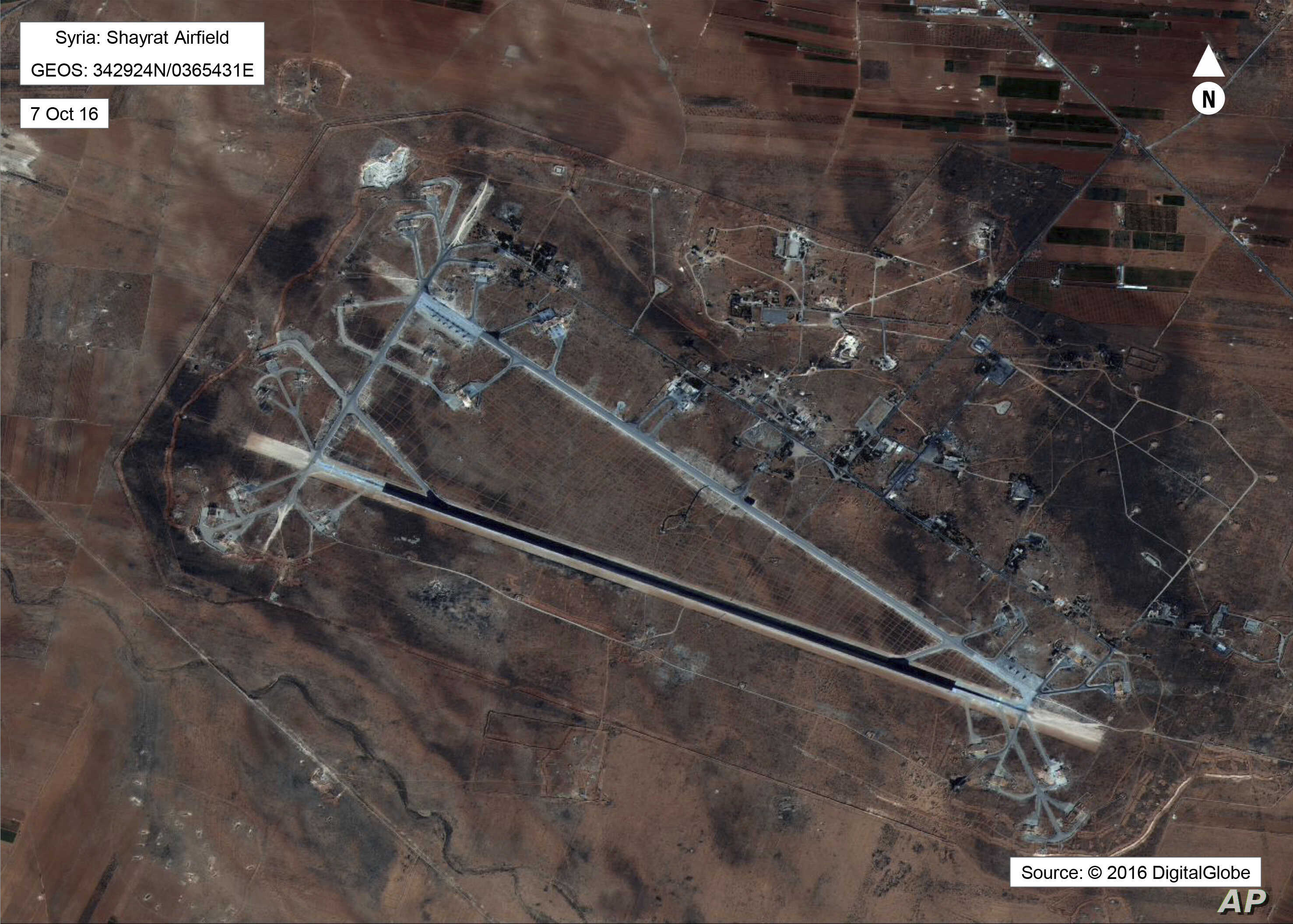 This Oct. 7, 2016 satellite image released by the U.S. Department of Defense shows Shayrat air base in Syria. The U.S. blasted a Syrian air base with a barrage of cruise missiles on April 7, 2017 in fiery retaliation for this week's gruesome chemical...