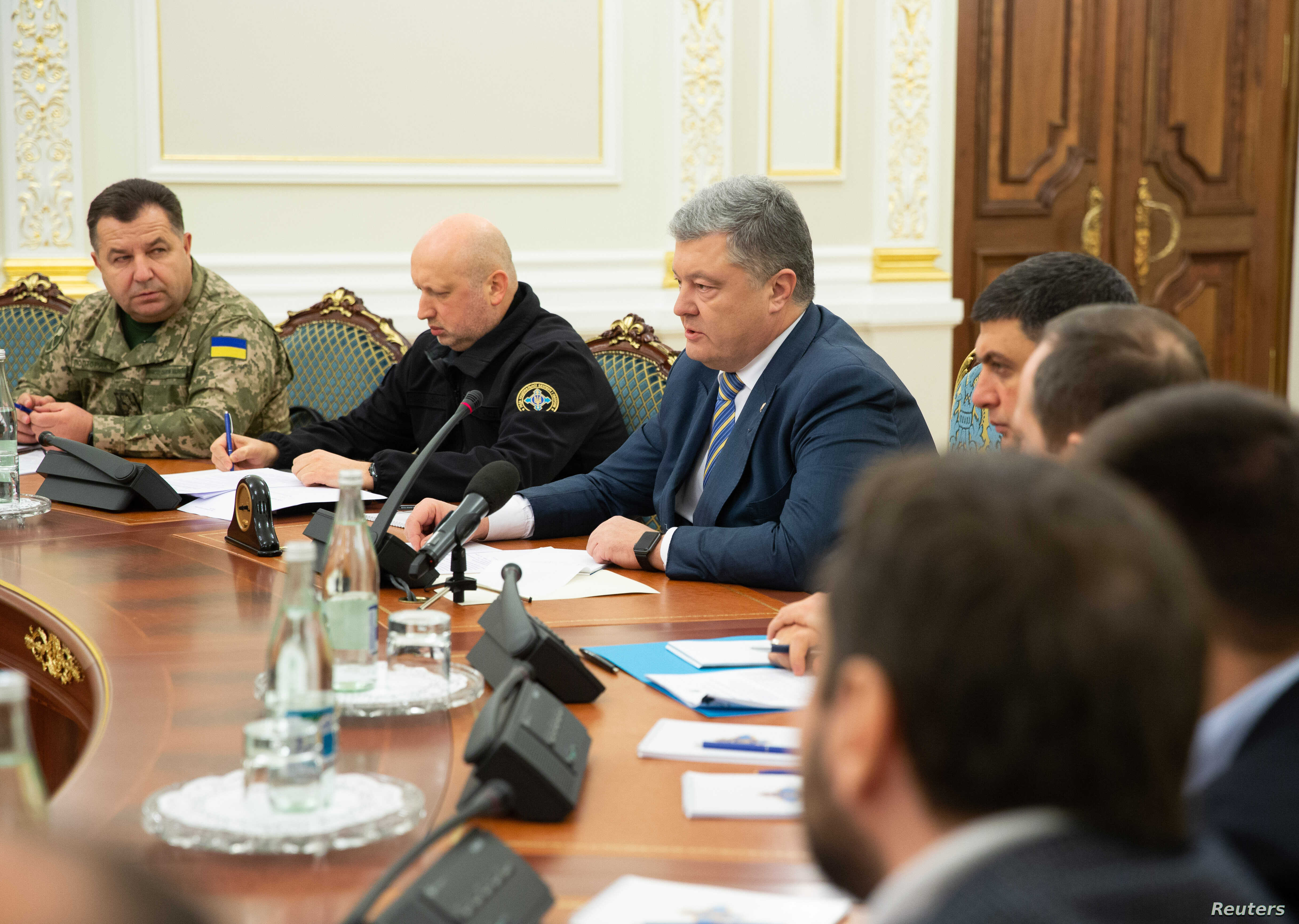 Ukrainian President Petro Poroshenko chairs a meeting of the National Security and Defense Council in Kyiv, Ukraine, Nov. 26, 2018.