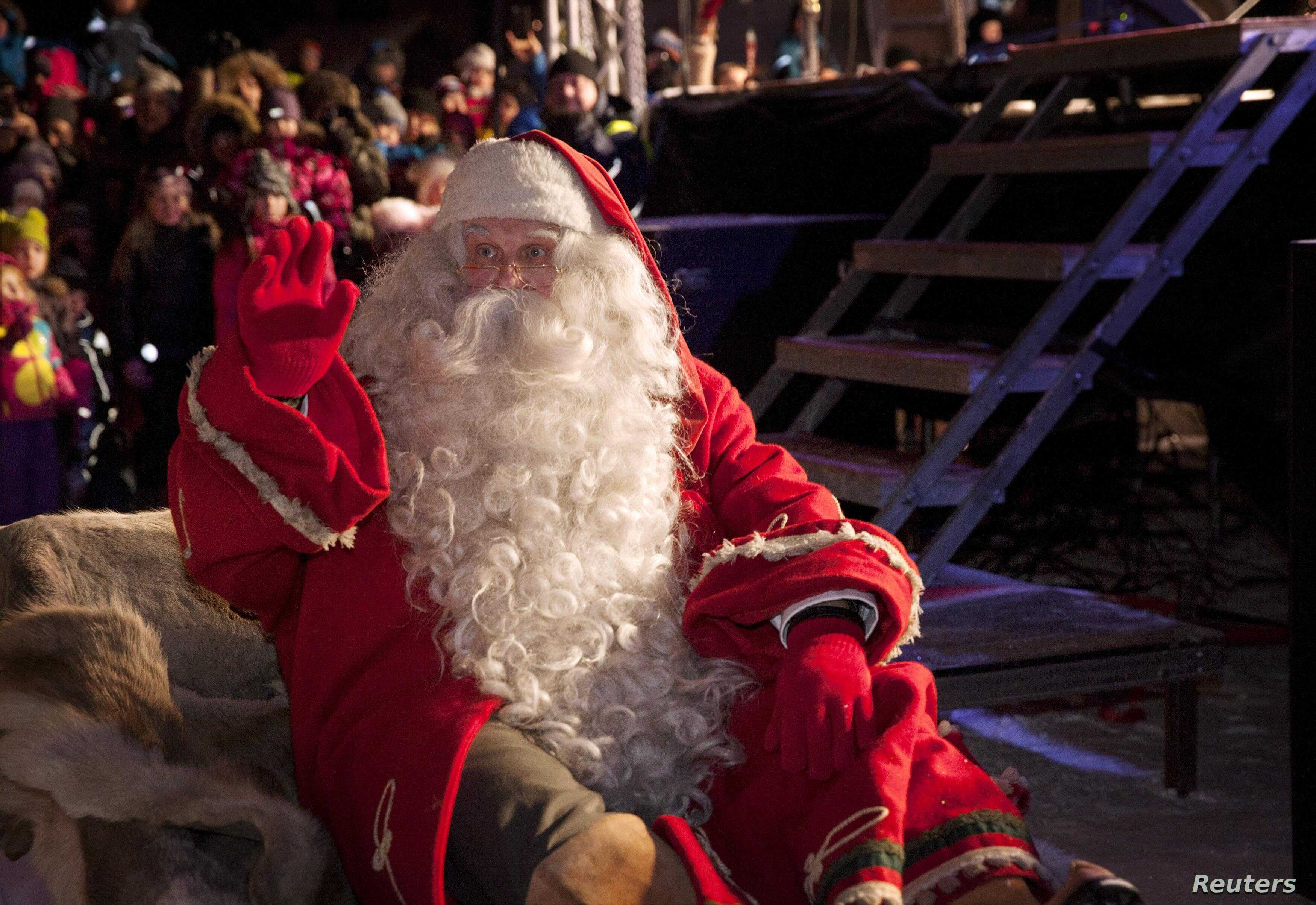 A man dressed as Santa Claus leaves for his annual Christmas journey from the Santa Claus Village at the Arctic Circle in Rovaniemi, Finnish Lapland, Dec. 23, 2014.