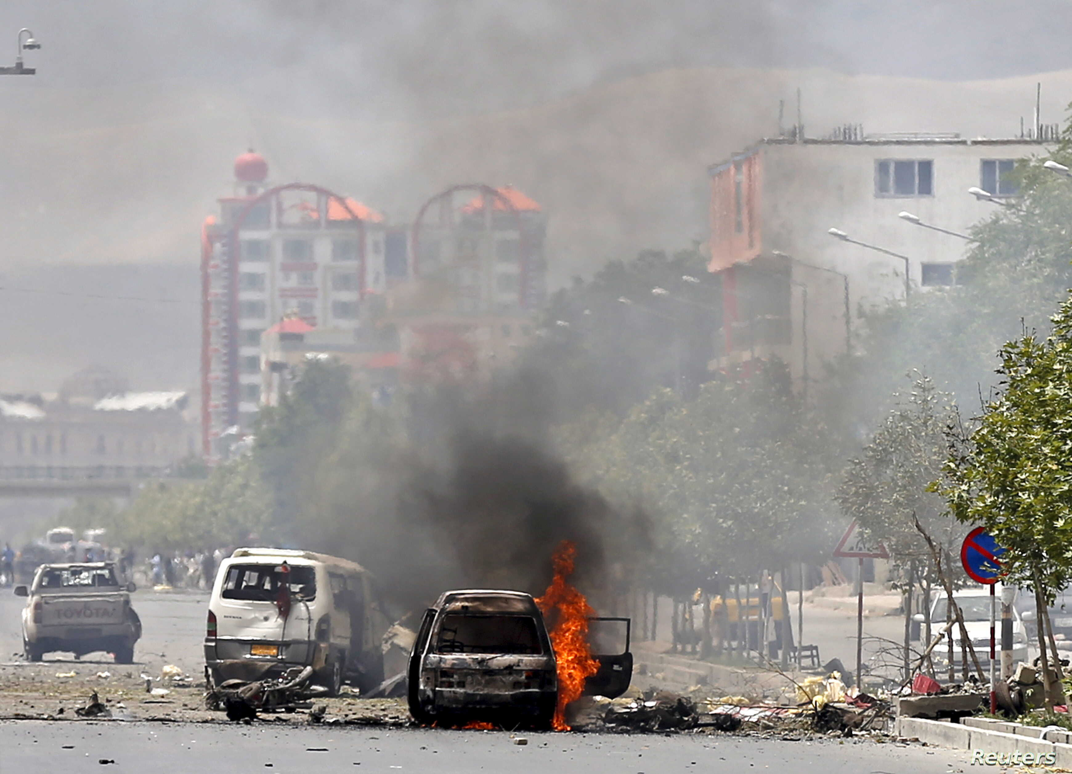 A vehicle is seen on fire after a blast near the Afghan parliament in Kabul, Afghanistan, June 22, 2015.