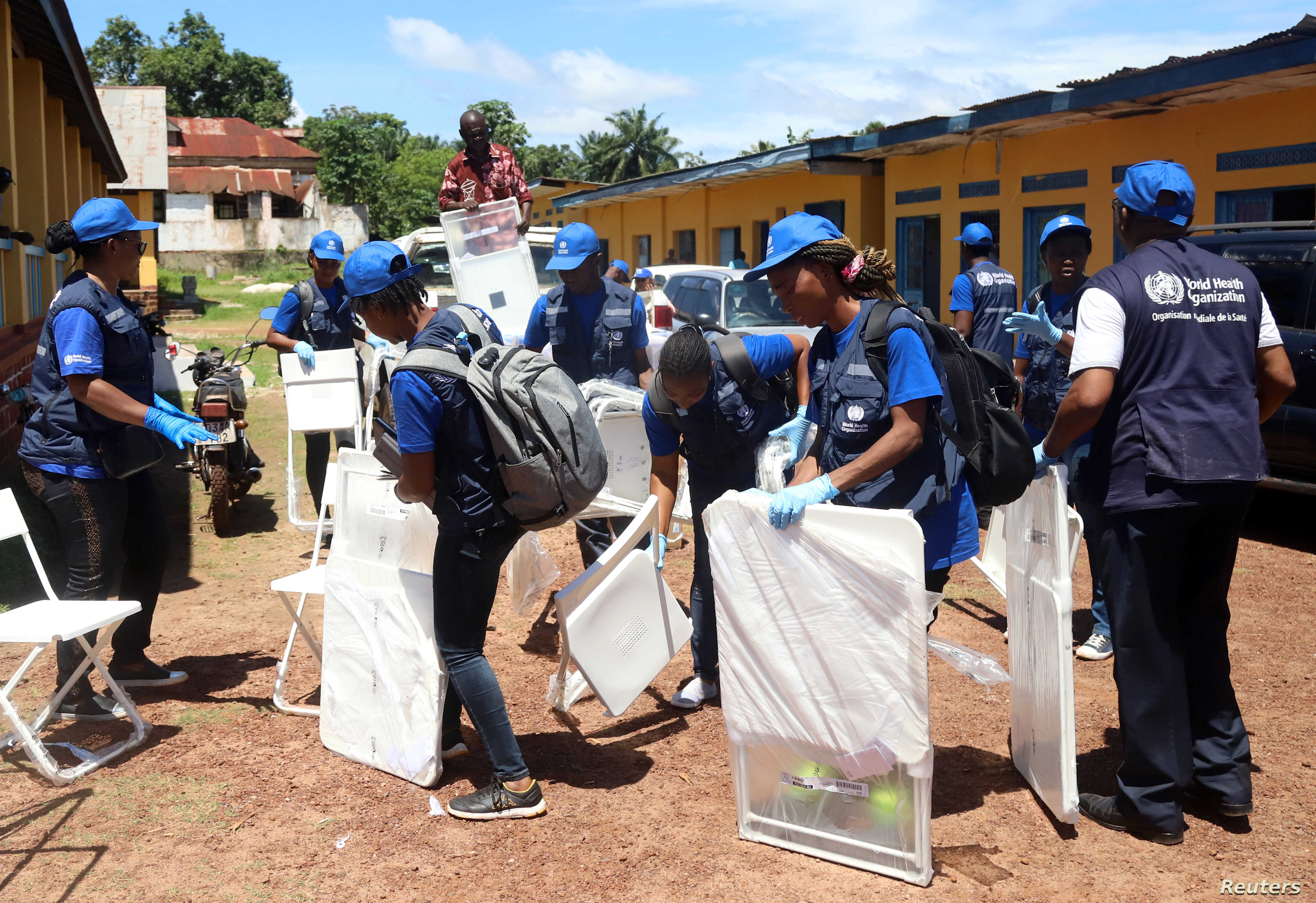 World Health Organization (WHO) workers prepare a centre for vaccination during the launch of a campaign aimed at beating an outbreak of Ebola in the port city of Mbandaka, Democratic Republic of Congo, May 21, 2018.