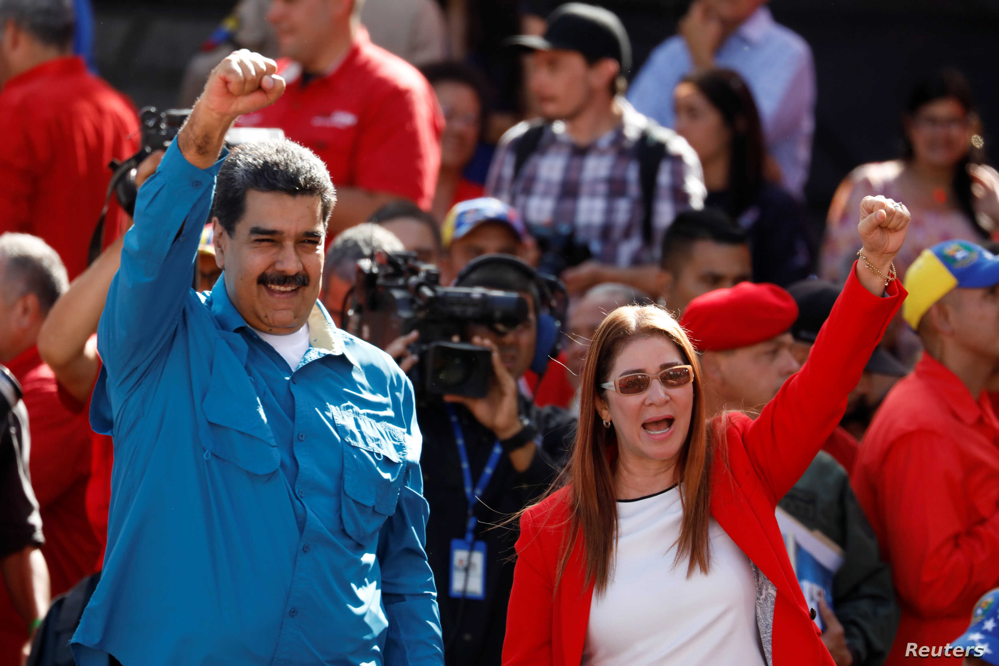Venezuela's President Nicolas Maduro and his wife, Cilia Flores, greet supporters at a rally marking the 60th anniversary of the end of dictator Marcos Perez Jimenez's regime, in Caracas, Jan. 23, 2018.