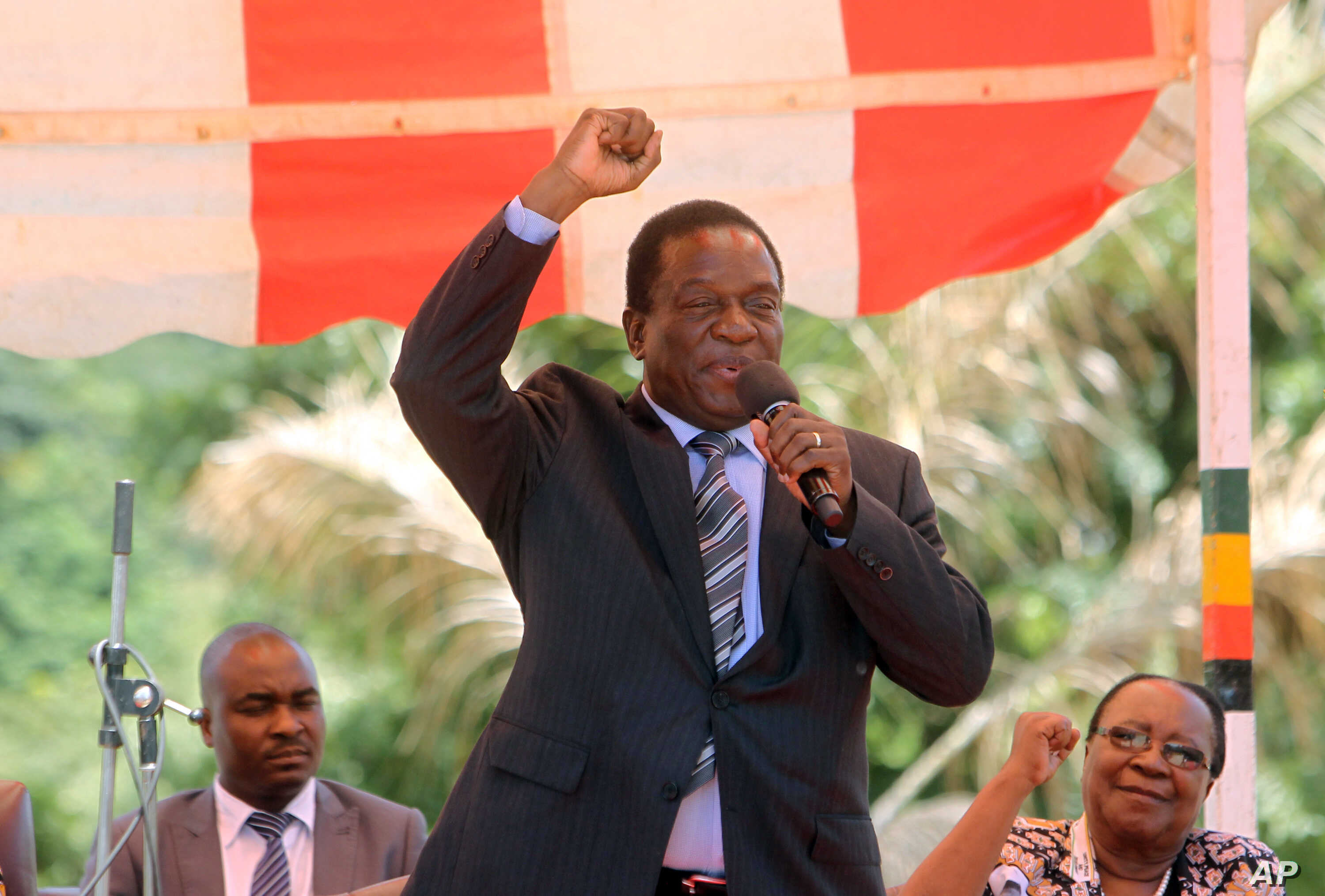 In this  image taken Feb, 10, 2016,  Zimbabwean  Deputy President Emmerson Mnangagwa greets party supporters  at the  ZANU-PF headquarters in Harare.
