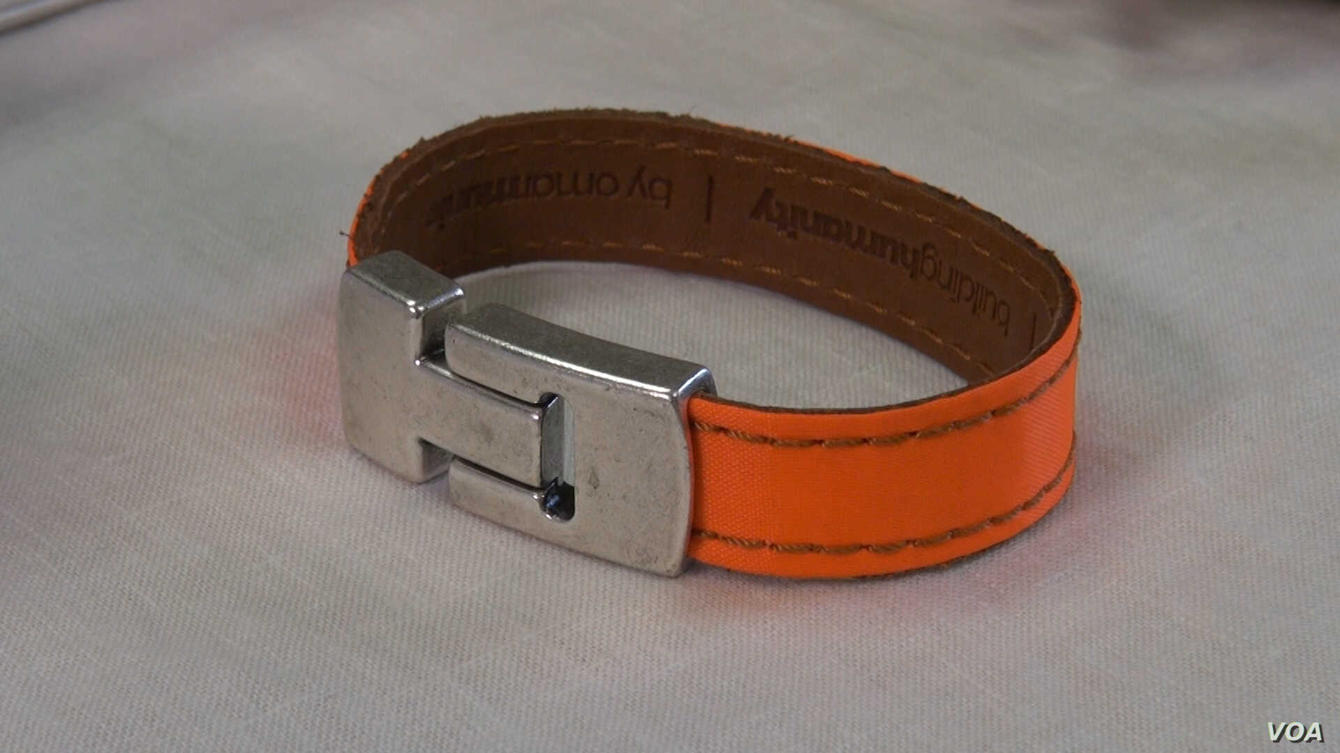 This bracelet is made from recycled life jackets. Half the proceeds go to organizations that help refugees.