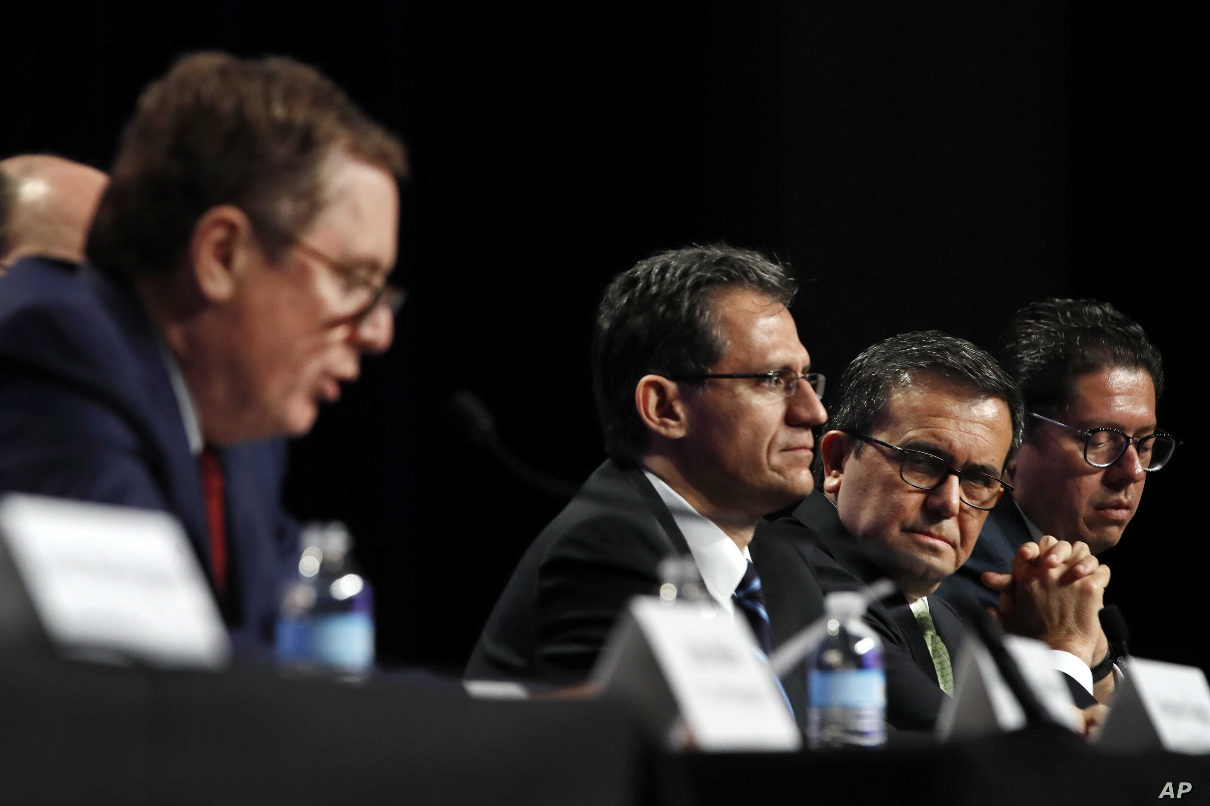 U.S. Trade Representative Robert Lighthizer, left, speaks while Mexico's Chief Technical Negotiator Kenneth Smith, Mexico's Secretary of Economy Ildefonso Guajardo Villarreal, and Mexico's Undersecretary of Foreign Trade Juan Carlos Baker, listen dur...