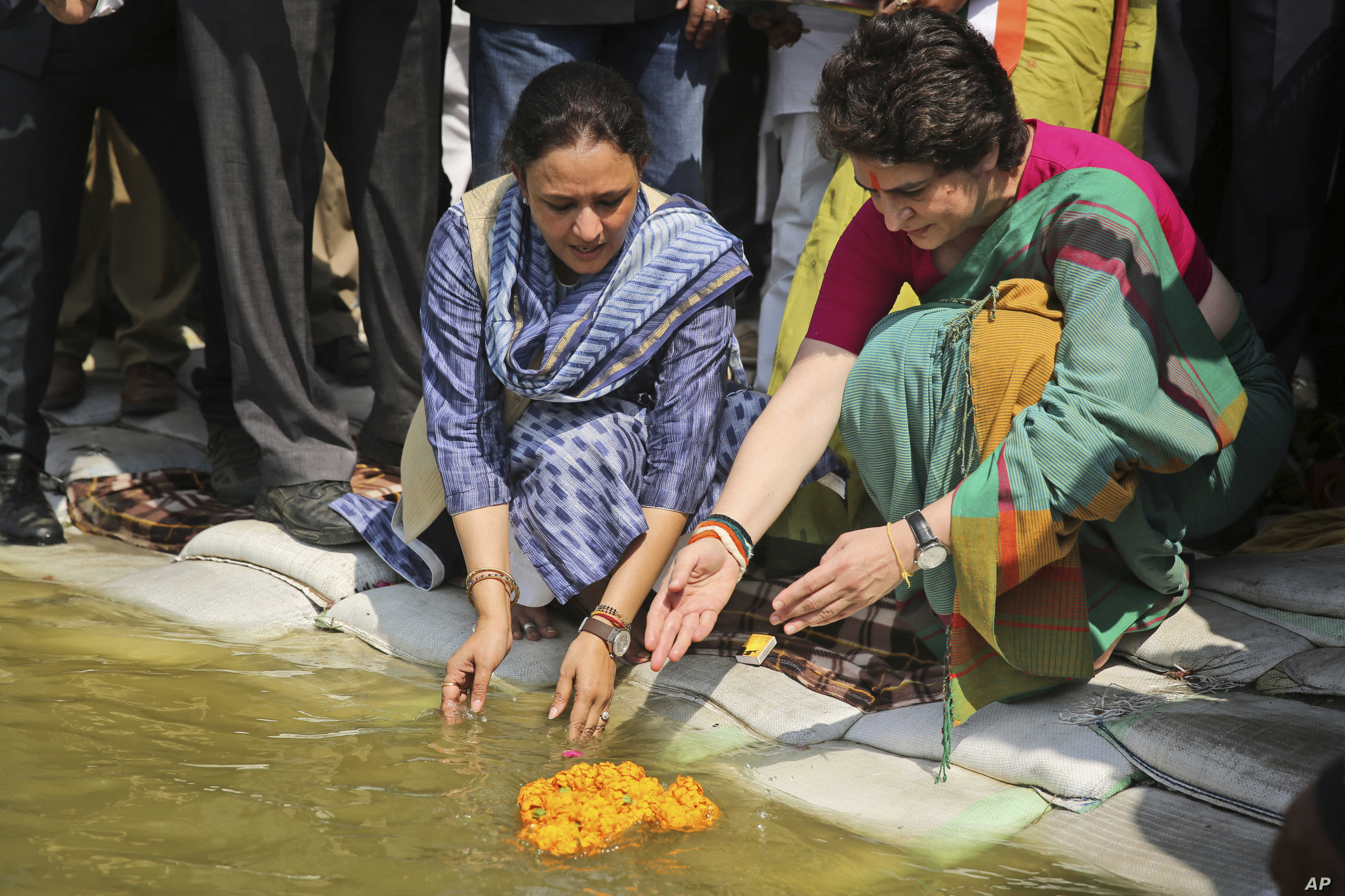 Congress party General Secretary and eastern Uttar Pradesh state in-charge Priyanka Gandhi Vadra, right, prays at the Sangam, the confluence of sacred rivers the Yamuna, the Ganges and the mythical Saraswati, in Prayagraj, India, March 18, 2019.