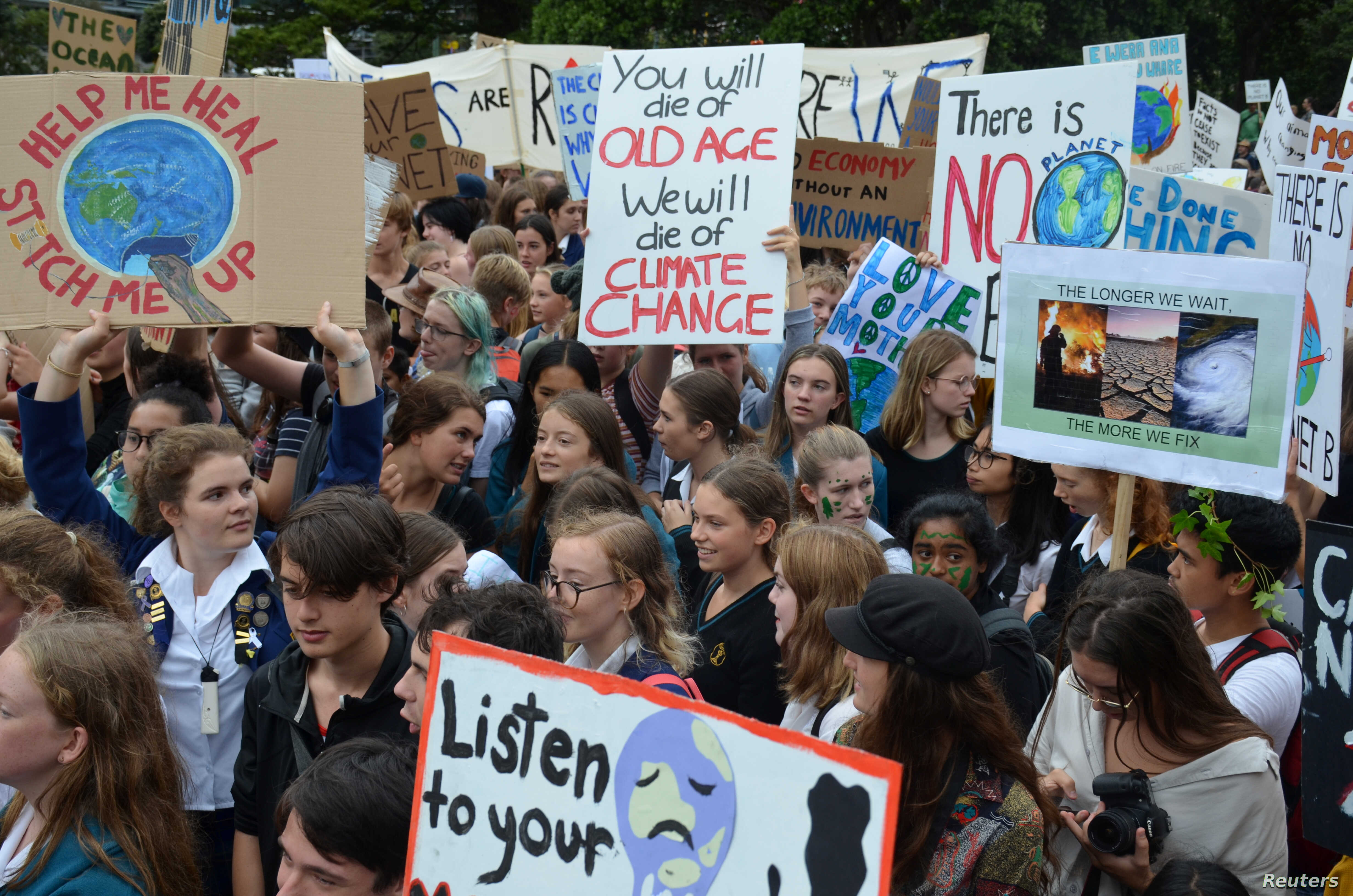 Students are seen during the global school strike for action on climate change outside New Zealand's parliament in Wellington, New Zealand, March 15, 2019.