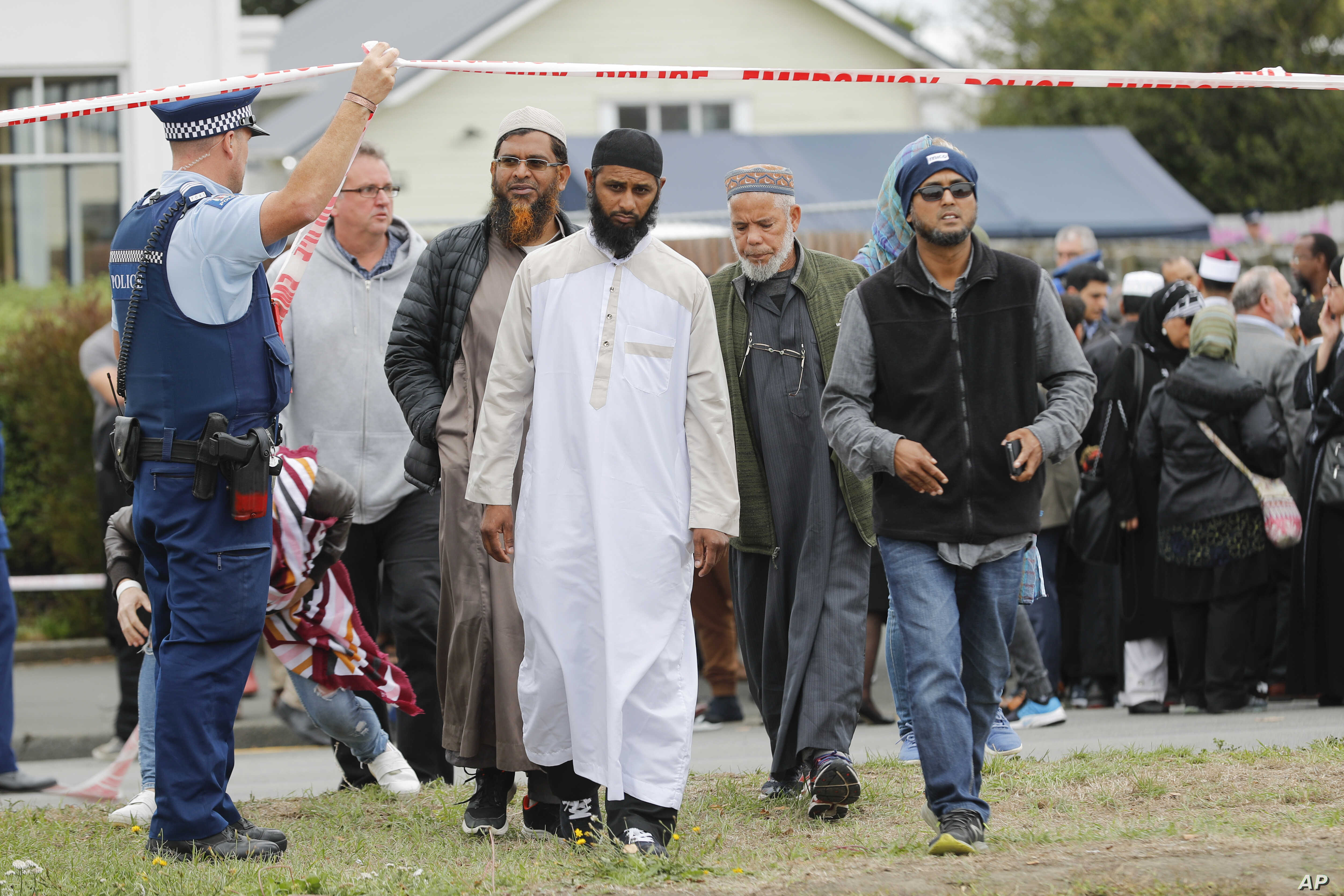 Members of Muslim religious groups leave after a special blessing ceremony near the site of Friday's shooting outside the Linwood mosque in Christchurch, New Zealand, March 18, 2019.
