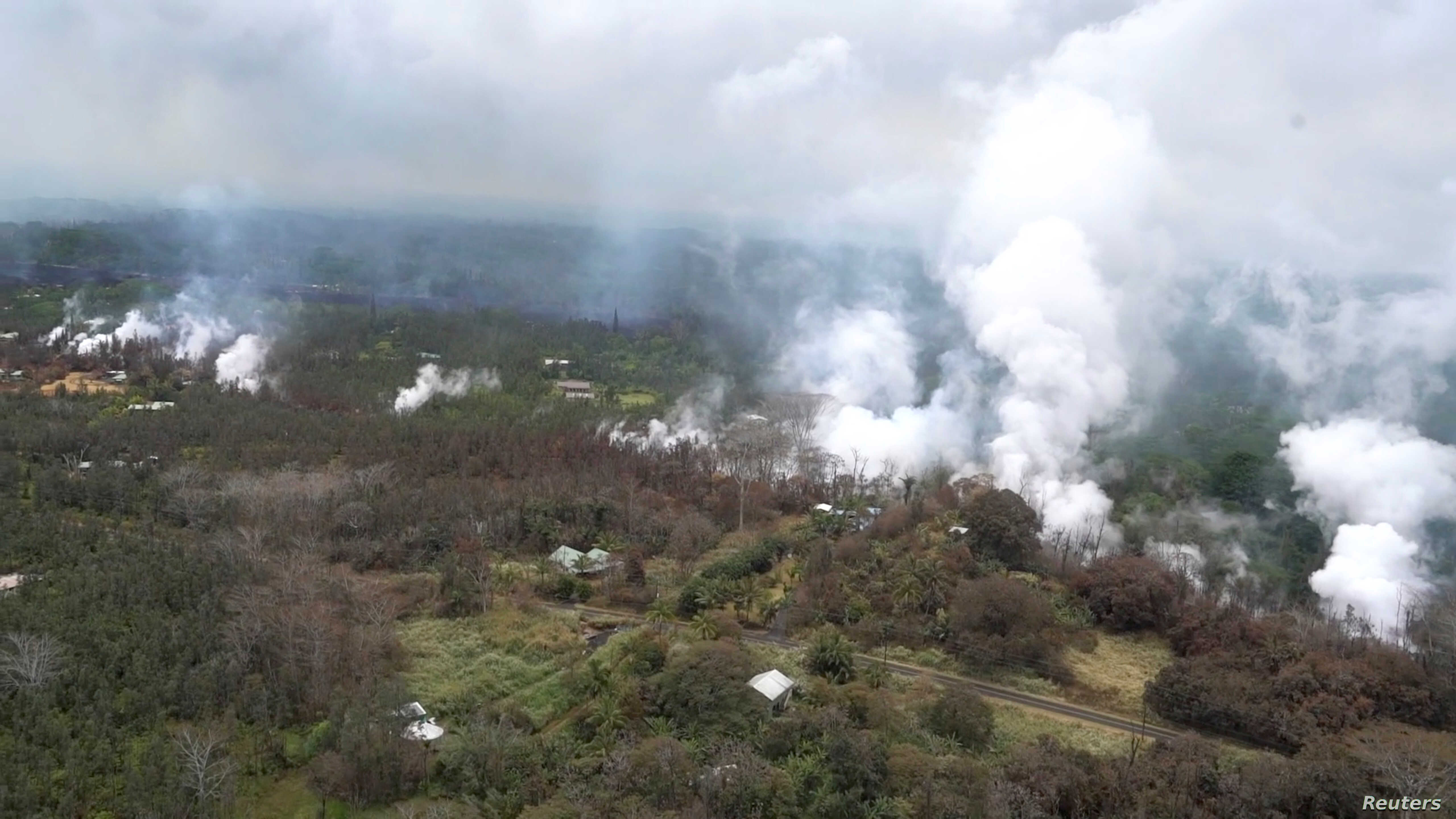 Molten rock flows and burst to the surface, threatening homes in a rural area in this still image from an aerial video taken from a Hawaii Army National Guard a week after the eruption of the Kilauea volcano, in Pahoa, Hawaii, May 10, 2018.