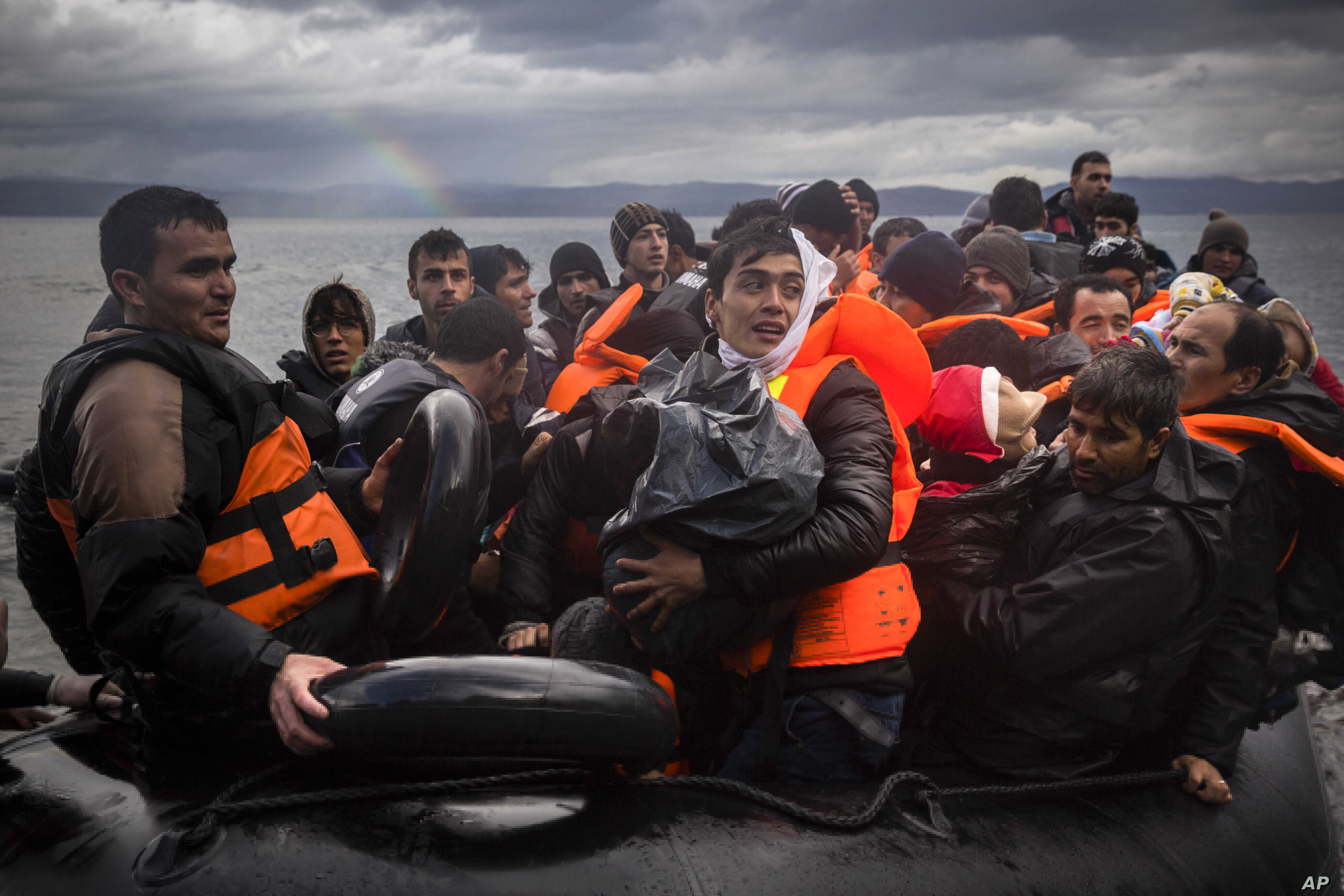 Refugees and migrants arrive on a beach after crossing a part of the Aegean sea from the Turkey's coast to the Greek island of Lesbos, Nov. 28, 2015.