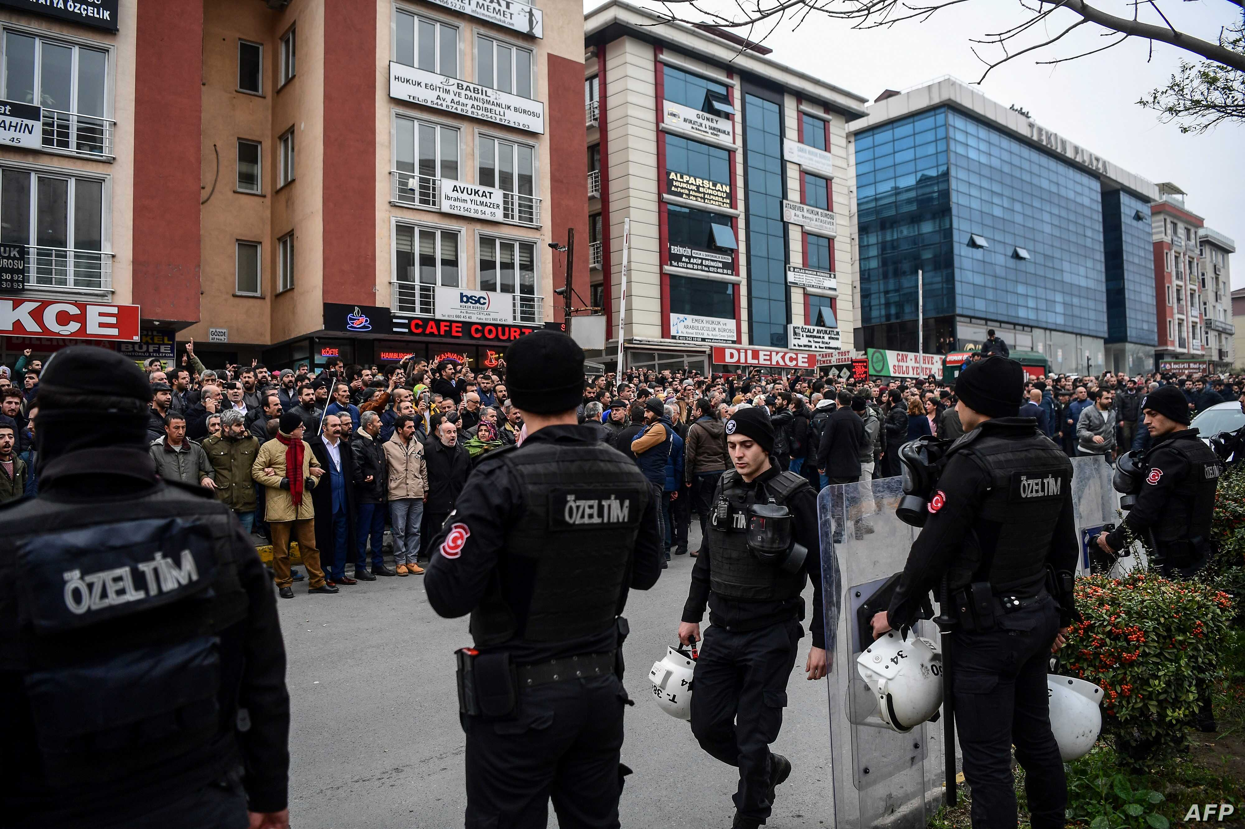Turkish anti-riot police officers stand guard as people gather outside Bakirkoy courthouse in Istanbul, Jan. 12, 2018, in support of the jailed co-chair of the Peoples' Democratic Party (HDP).