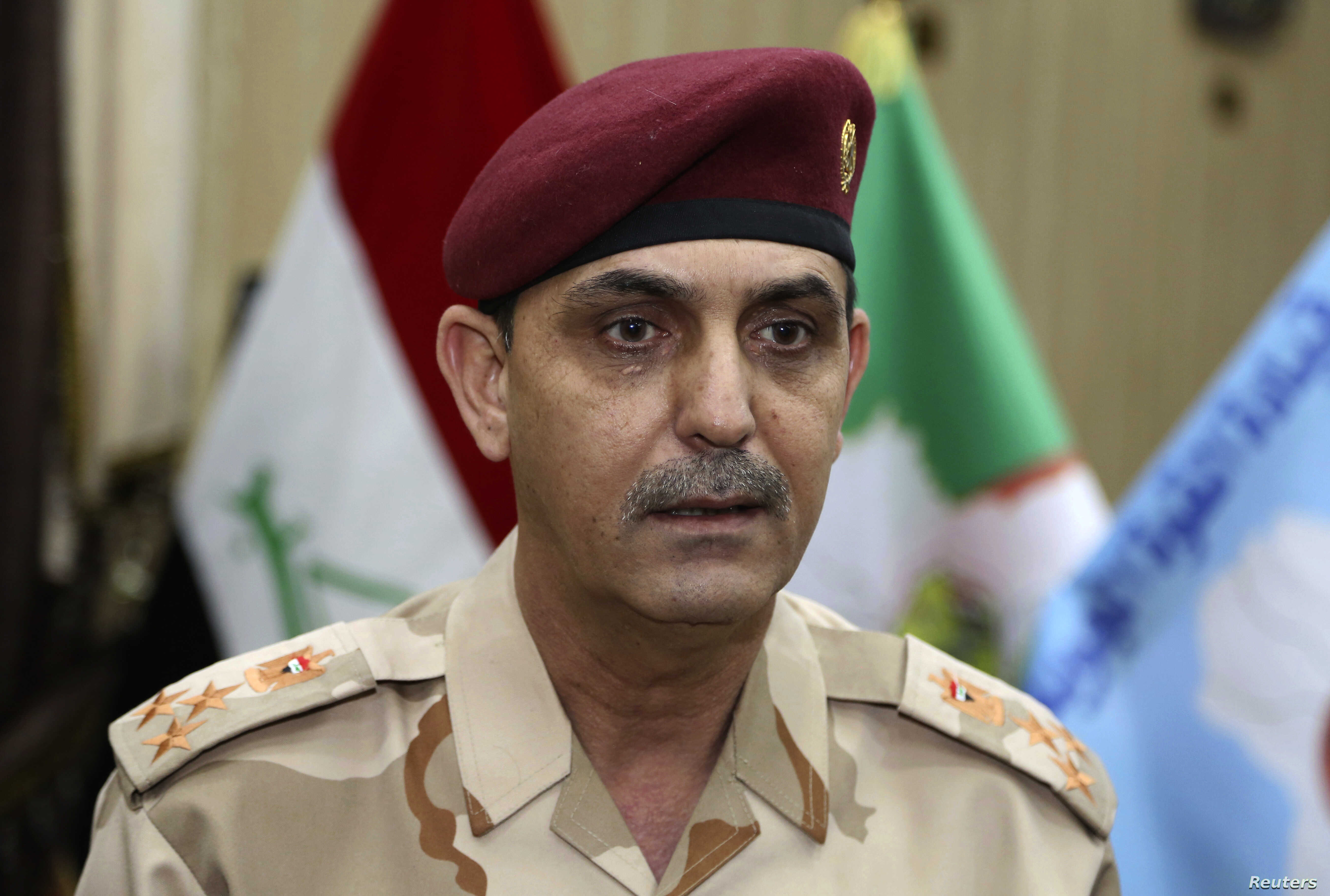 Brig. Yahya Rasooli, an Iraqi joint command spokesman, speaks during an interview with The Associated Press in Baghdad, March 28, 2017.