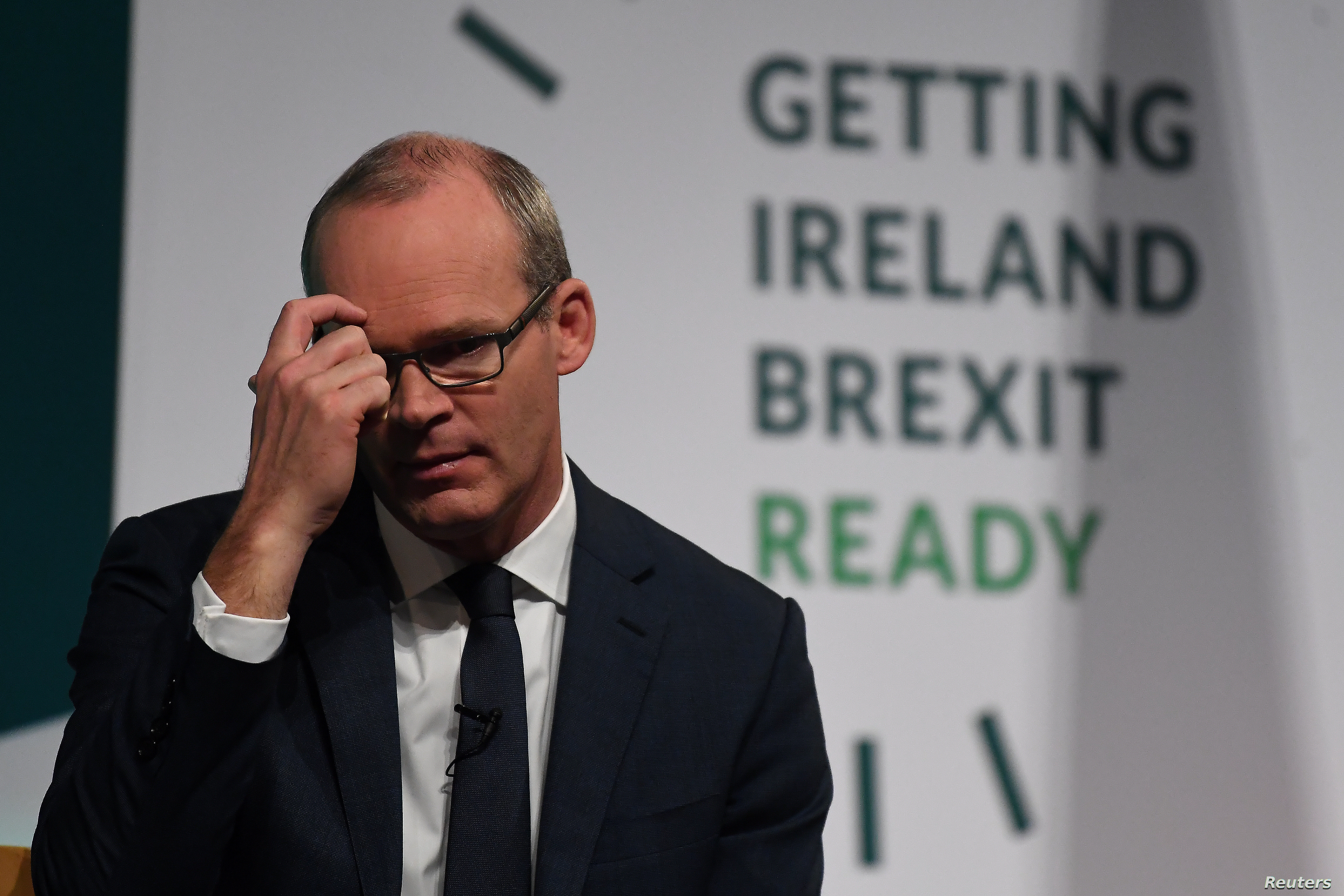 FILE PHOTO: Ireland's Minister for Foreign Affairs and Trade, Simon Coveney, speaks at a 'Getting Ireland Brexit Ready' workshop at the Convention Center in Dublin, Oct. 25, 2018.