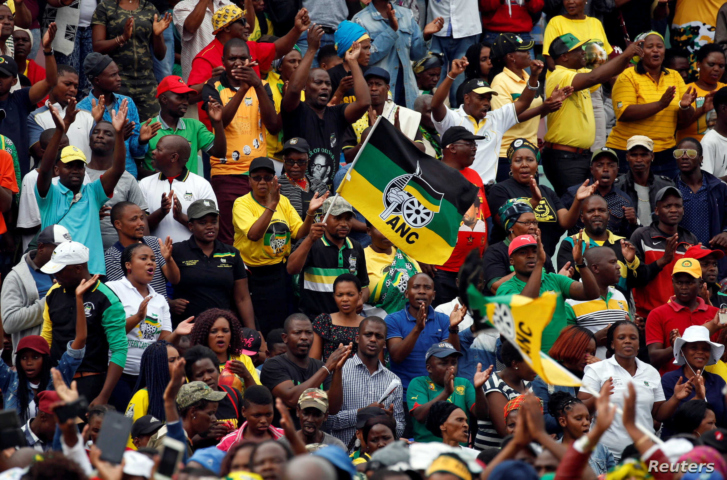 Supporters of the ANC wave a flag during the party's 106th anniversary celebrations, in East London, South Africa, Jan. 13, 2018.