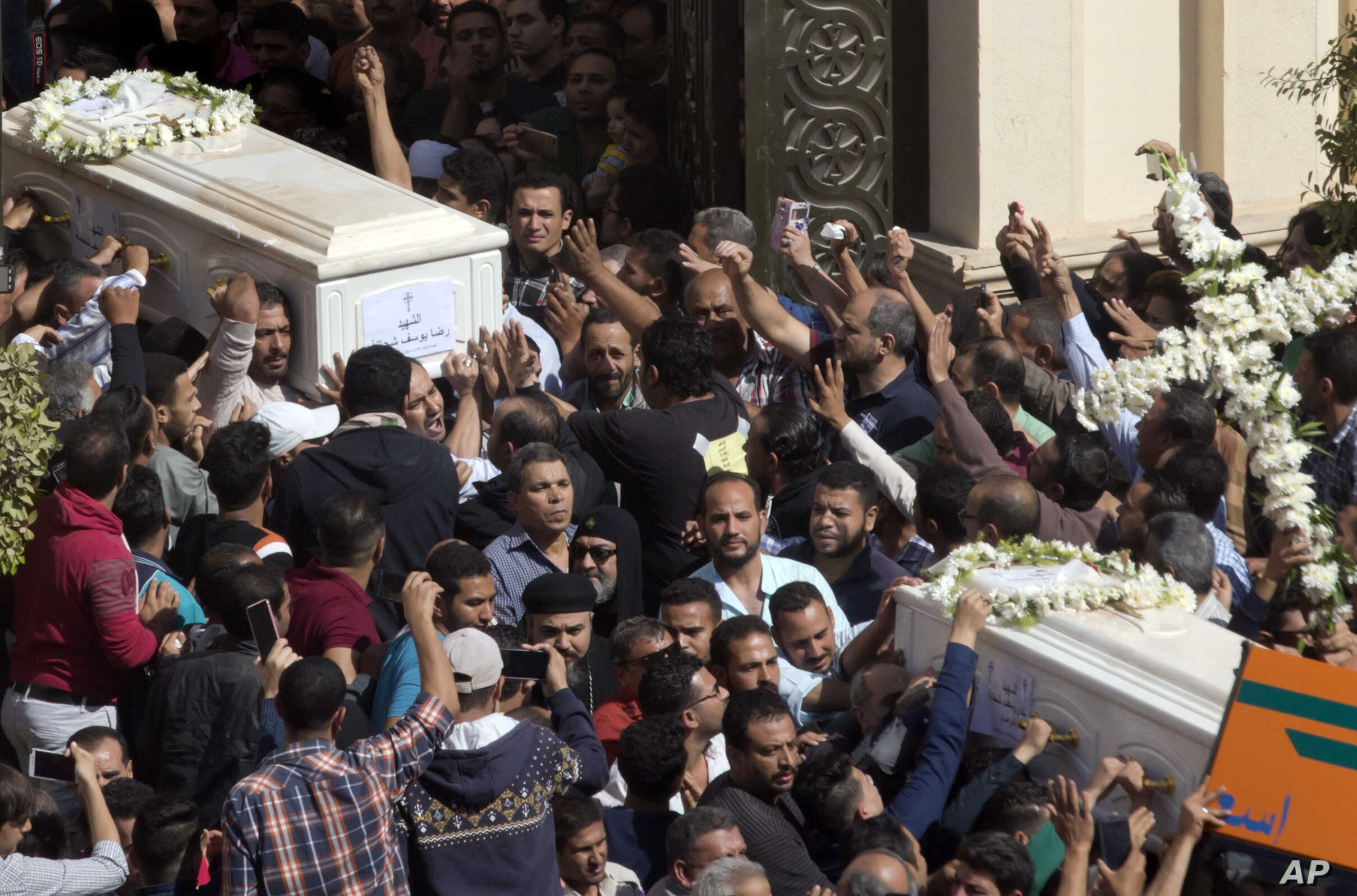 Relatives and friends carry the coffins of brothers Nadi Yousef Shehata, right, and Reda Yousef Shehata, two of the seven victims of an Islamic State ambush, in Minya, Egypt, Nov. 3, 2018.